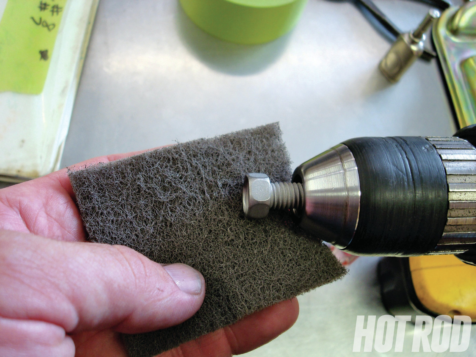 Drill Finish Give stainless or plated bolts a nice satin finish by chucking them in a drill and running them over a fine (gray) scuff pad.