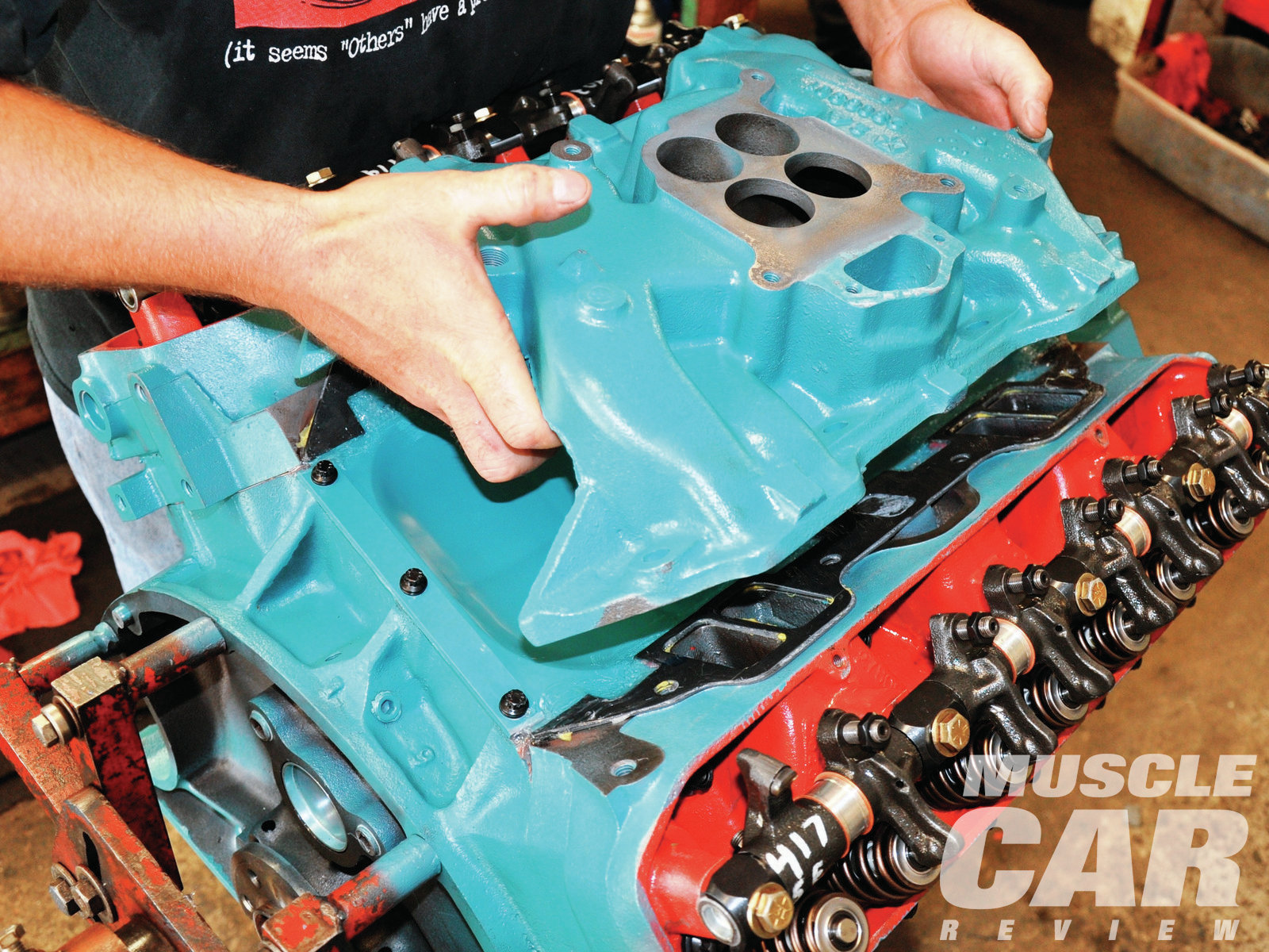 16 With gaskets, intake, and bolt holes lined up, the right amount of gasket sealer was applied and the intake installed.