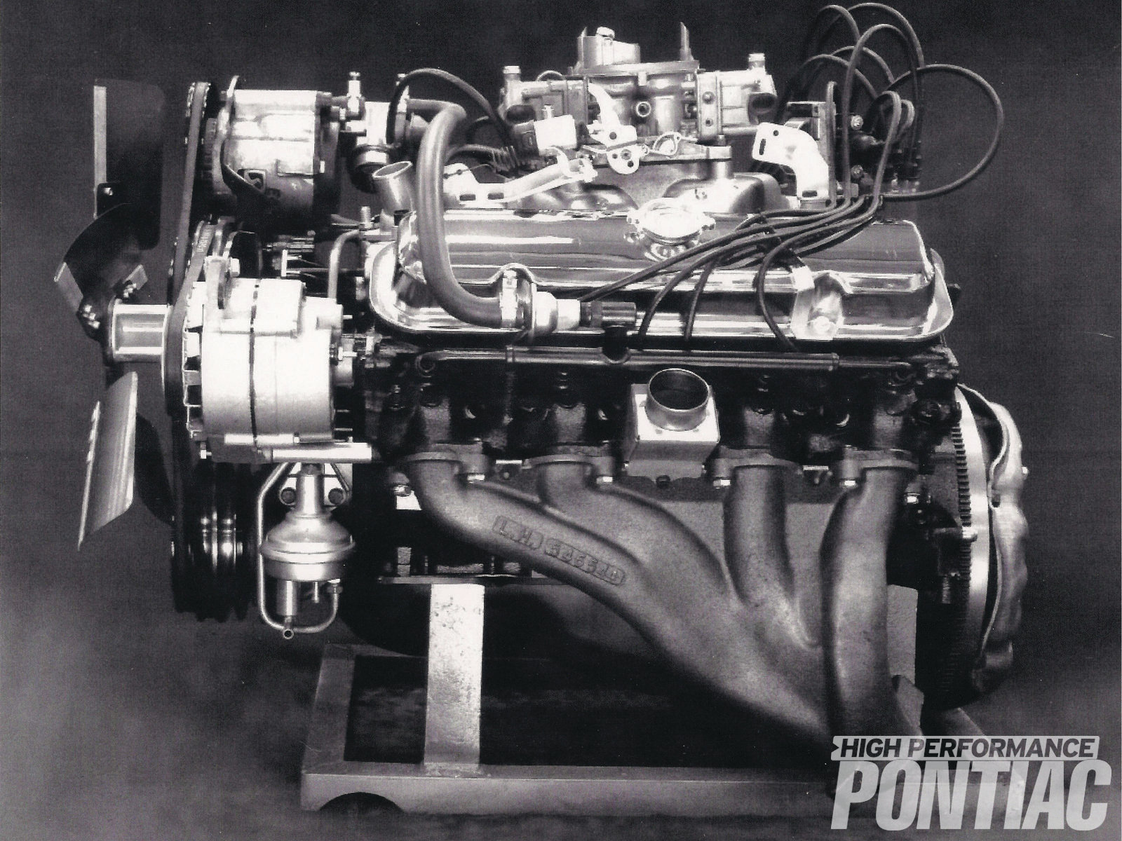 This vintage Pontiac publicity photo shows a dressed-out tunnel-port 303. The photo was likely arranged to show SCCA officials that the Pontiac 303 was a production engine.