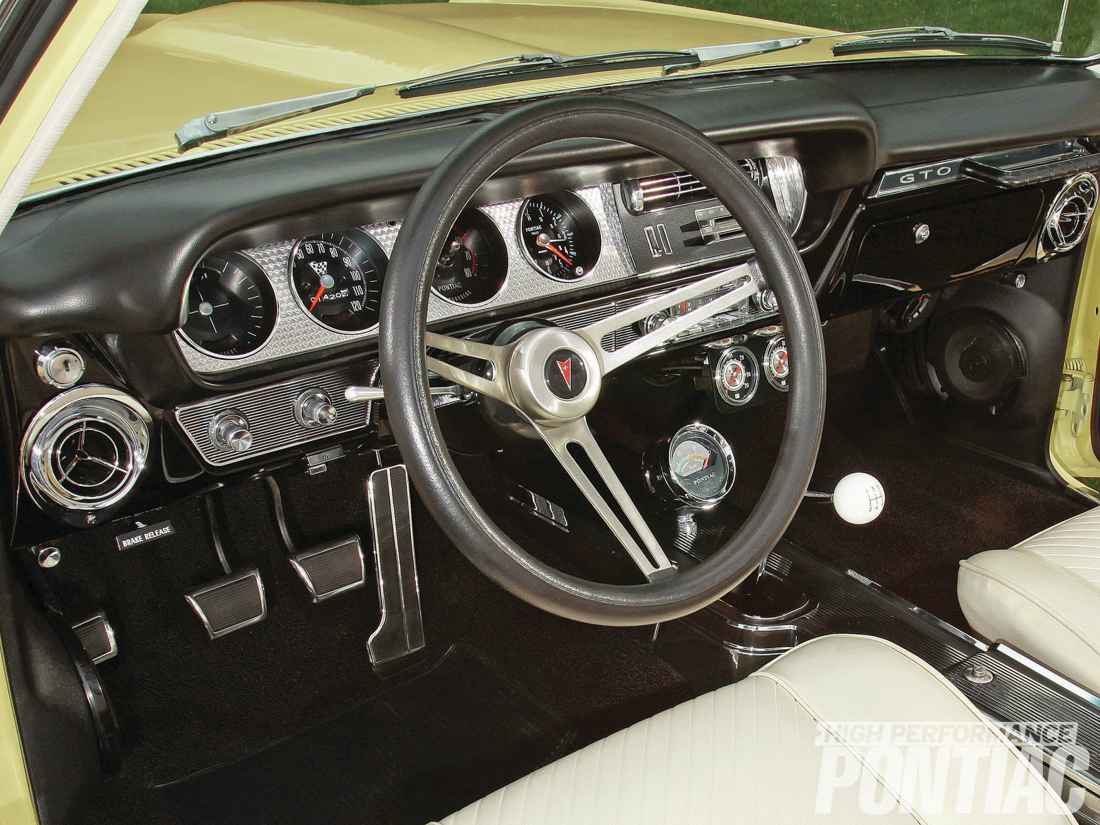 Brad prefers the look of '64 GTO engine-turned dash trim, the comfort of the Grant wheel's thick grip, and the adjustability of the Flaming River tilt column. Auto Instruments restored a factory speedo, tach, clock, and vacuum gauges. The A/C dash panel, controls, and vents were sourced from GTO Goodies for a stock look, while the Vintage Air system controller resides in the glovebox.