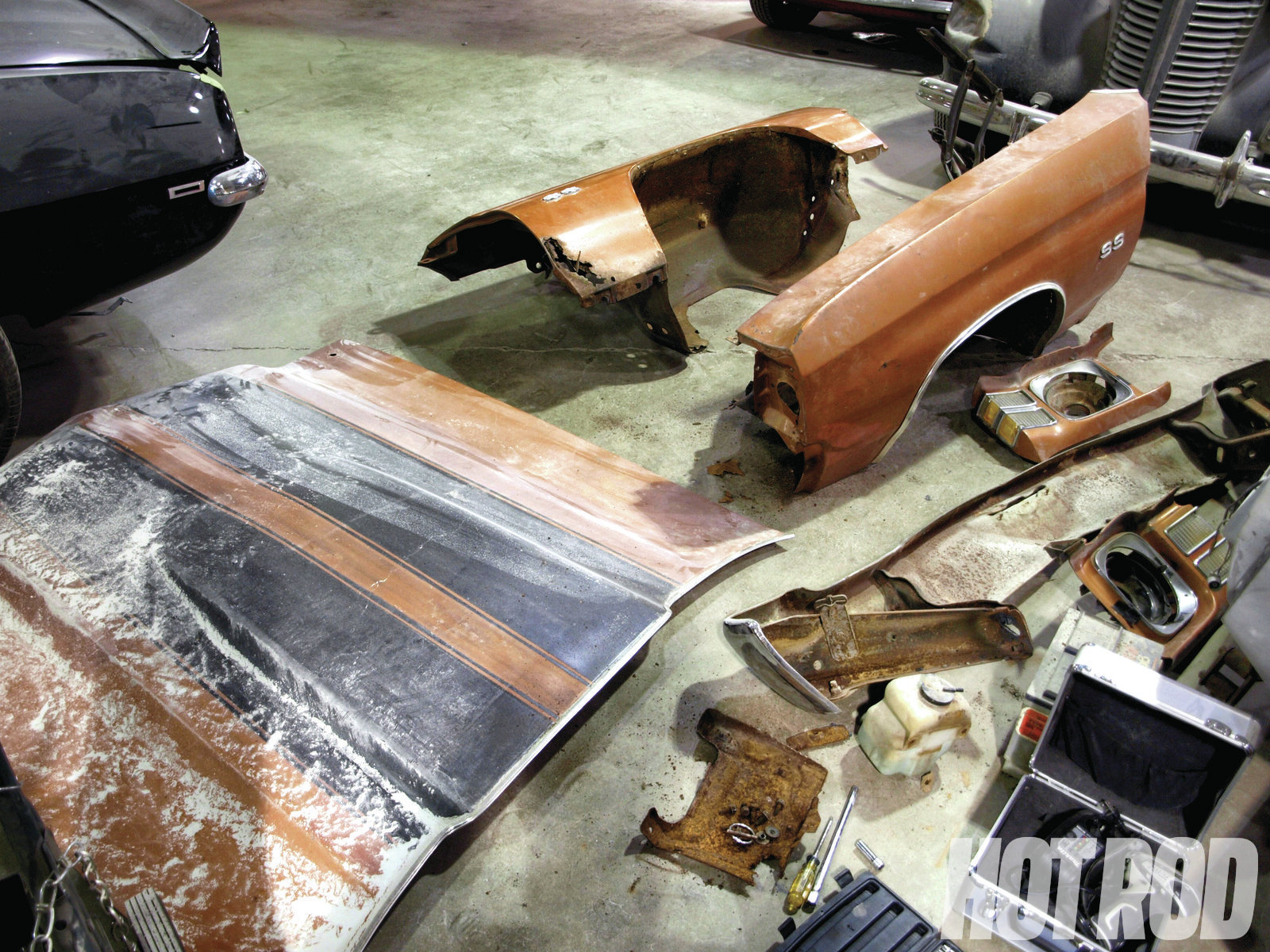 Upon dissembling the body panels to assess the extent of the rot, the hood, fenders, trunklid, doors, and quarter-panels were deemed unsalvageable. The cowl, floorboard, and trunk floor had sustained severe rust damage as well.