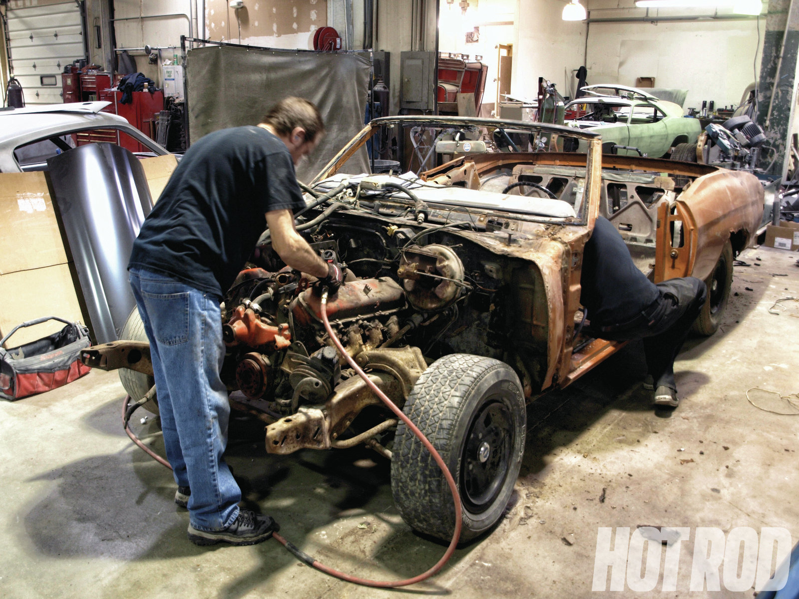 The front clip was removed, and the motor and trans were pulled for inspection. Since both the 402 big-block and Muncie four-speed were original to the Chevelle, Precision Restorations rebuilt them back to factory specifications in-house.