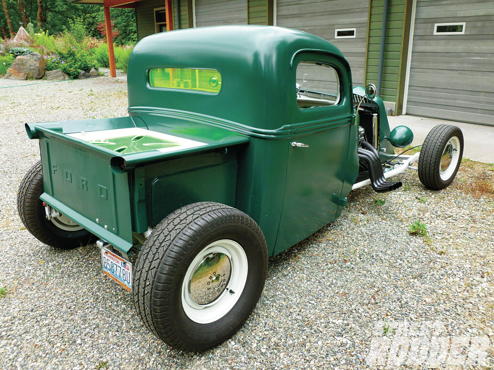 The bed sides are sectioned pieces from a '40 Ford while the tailgate is from a '56 Ford.