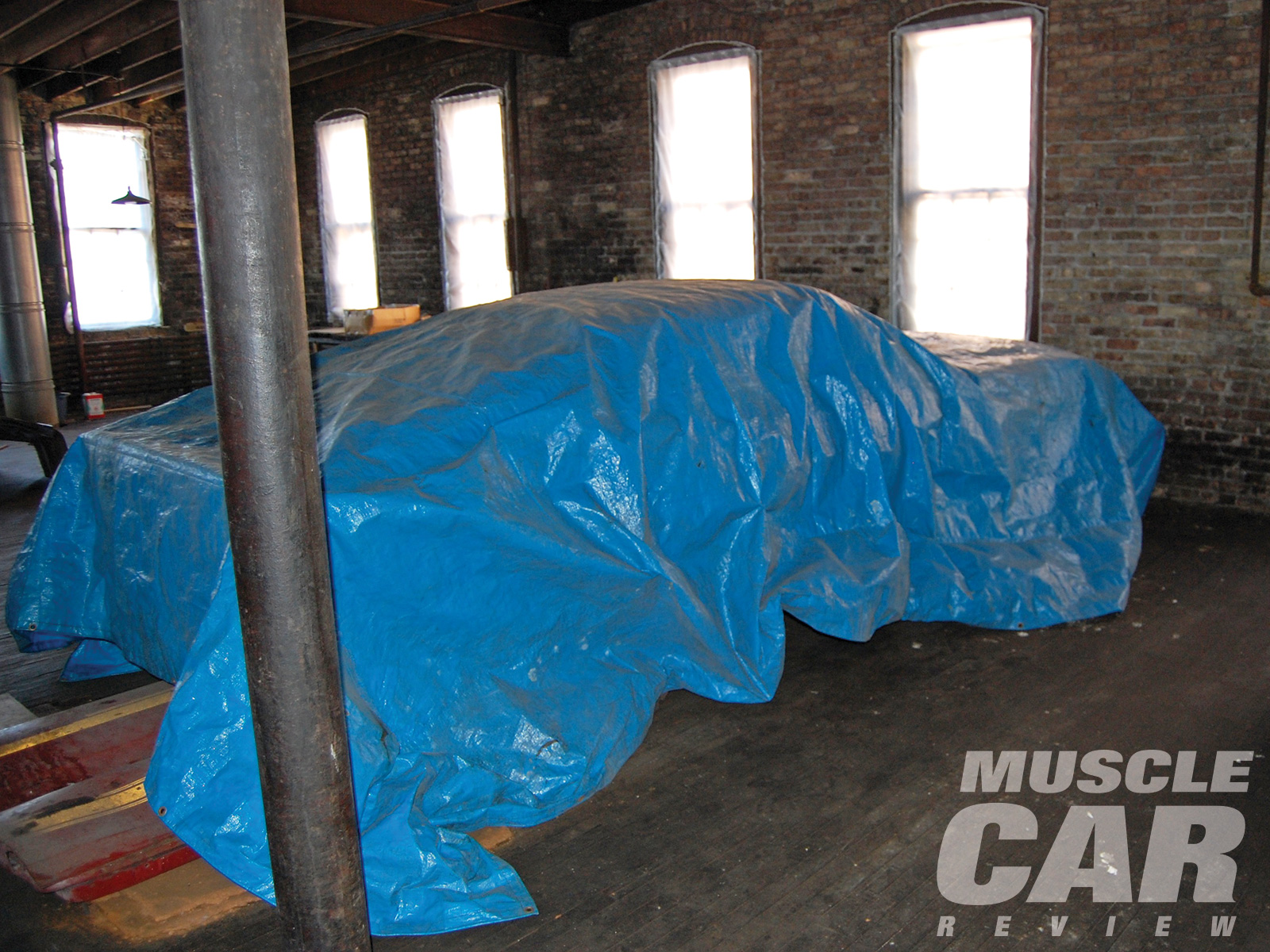 Mark Barton's Rare Find was covered with a tarp sitting on a wooden floor in a heated room above an attorney's office.