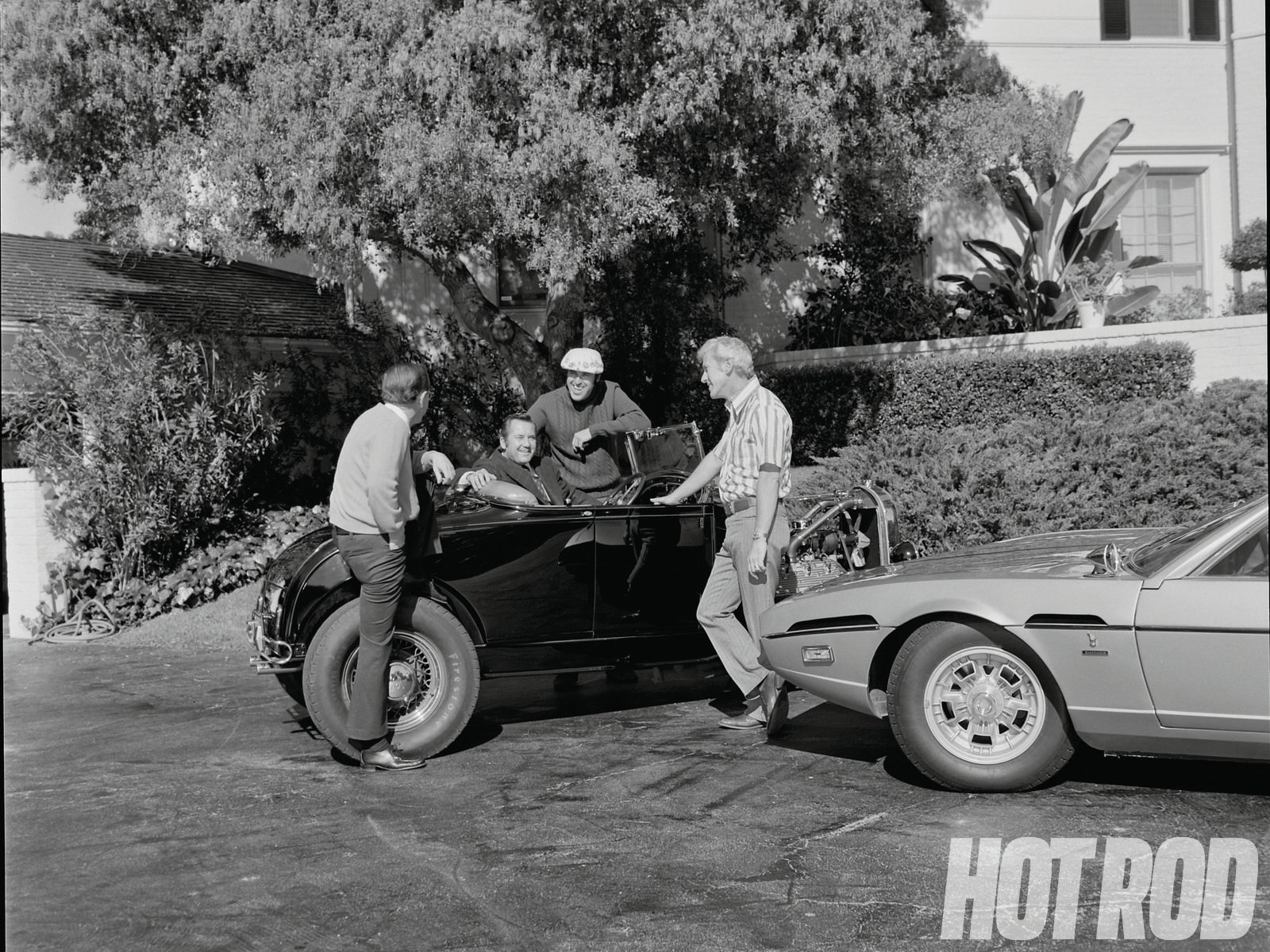 While Pete owed his start to hot rods, he was far more interested in outdoorsmanship. We have very few photos of Petersen with hot rods. Here's one, though, shot in 1973 with Bud Bryan's roadster from Rod & Custom on the occasion of that magazine's 20th anniversary. That's Tom Medley on the left, Petersen at the wheel, editor Bud Bryan, and R&C's first editor Spence Murray.