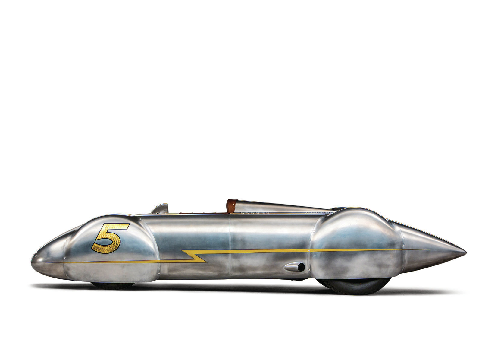With no rollbars or bumpers, the So-Cal streamliner takes on the most slippery shape imaginable. The crowned surfaces were originally created at Valley Custom in Burbank and were confined to nose, tail, and wheel blisters. All the other panels were rolled or flat and were handled by the So-Cal crew to costs.