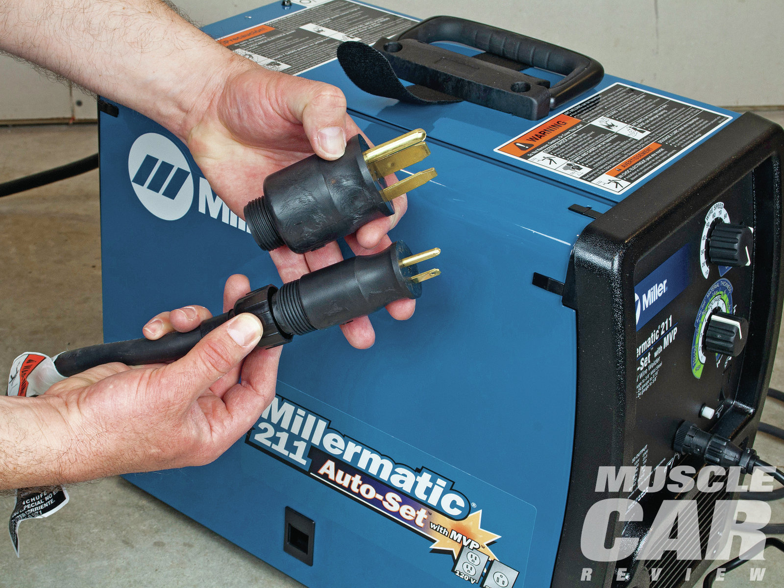 The Millermatic 211 Auto-Set can run on either voltage by simply changing the plug on the end of the power cord. This is handy if you will be operating the welder in a variety of locations and won't always have access to 220V power, or if you only have 120V service now and want to upgrade after buying a MIG welder. Naturally, when it is connected to a 120V source the Millermatic is limited in its power output just like any other 120V machine.