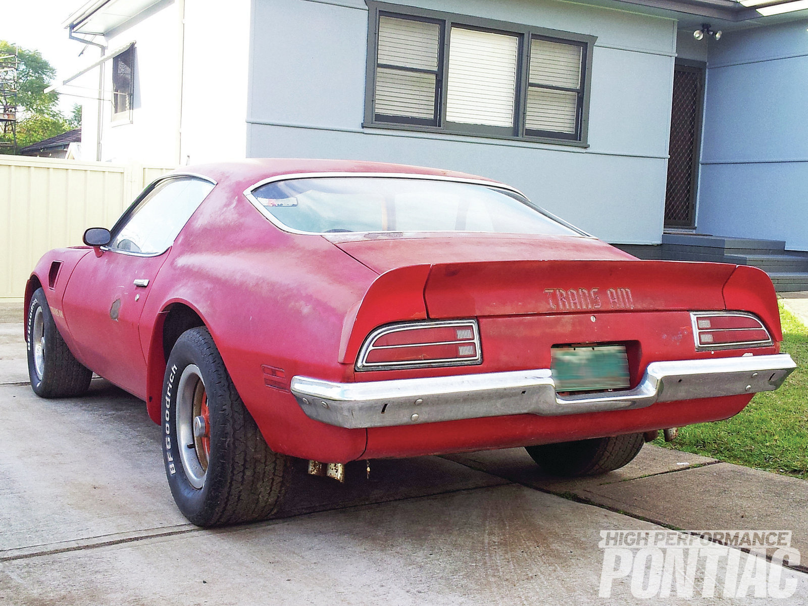 Originally Buccaneer Red, its exterior has been repainted at least once, and the incorrect decals were used in places. For a Firebird that's fast approaching 40 years old, the sheetmetal is remarkably clean. Note the aforementioned holes in the bumper for rear bumper guards.