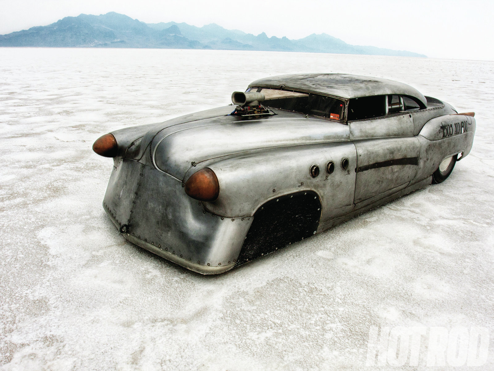 Jeff Brock came across this '52 Buick Super Rivera at an abandoned sawmill. With the assistance of his crew chief, Sergio Juarez, they have bumped the XO/GCC record by 35 mph since they first came to Bonneville in 2009. Follow them at RocketHeadsRacing.com. The chassis and suspension were influenced by Bonneville veterans Jim Kitchen and Rich Fox. The front suspension is a solidly mounted, dropped I-beam from a '68 Chevy van that was narrowed 13 inches. The five-link rear suspension allows only 1 inch of compression travel.