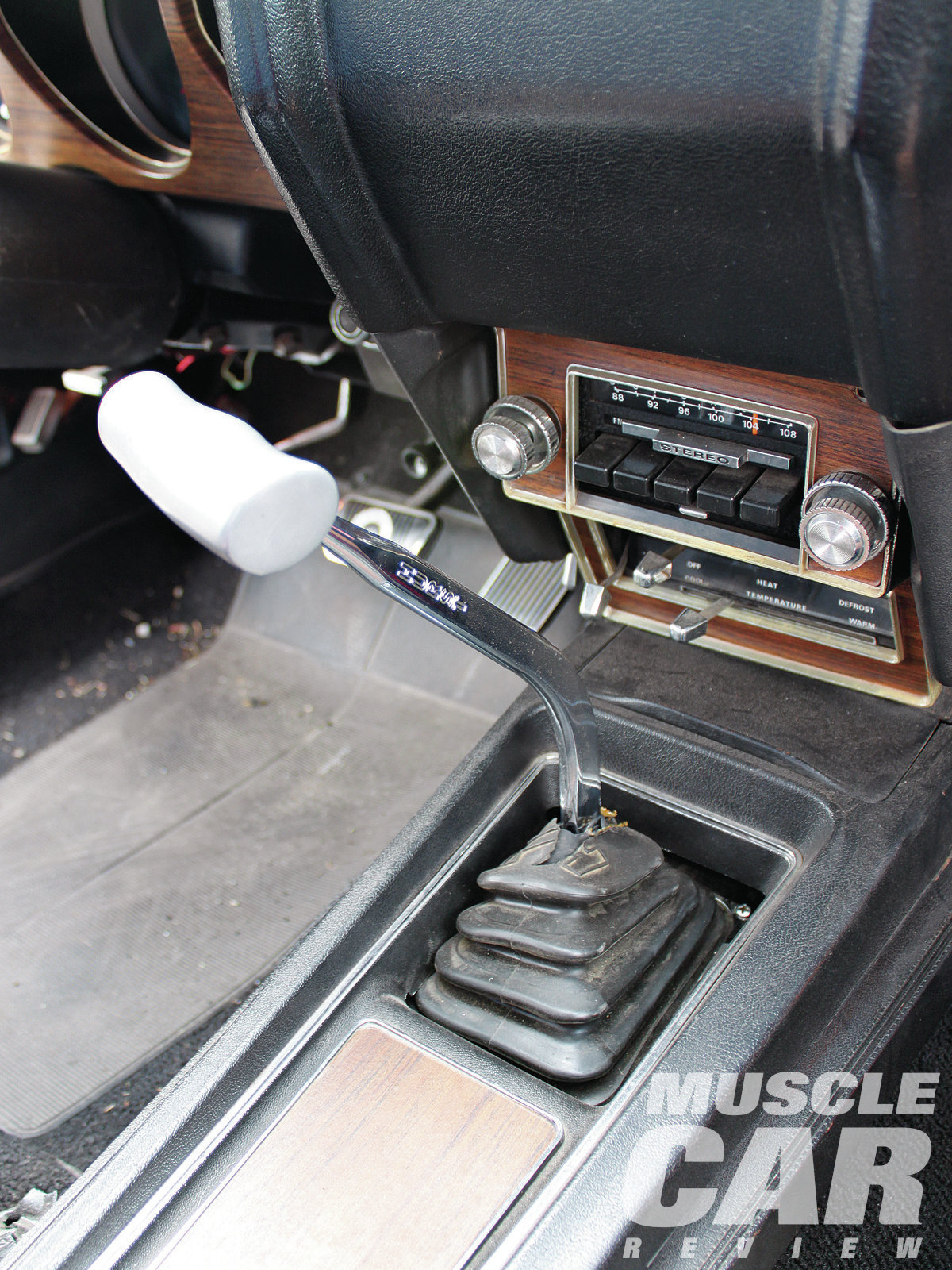 After the car's original drivetrain was stolen, a junkyard put in a standard 429 and a C6 automatic to make it a driver again. Keith replaced the engine and the trans using a NASCAR Toploader four-speed stirred with this Hurst T-handle shifter.