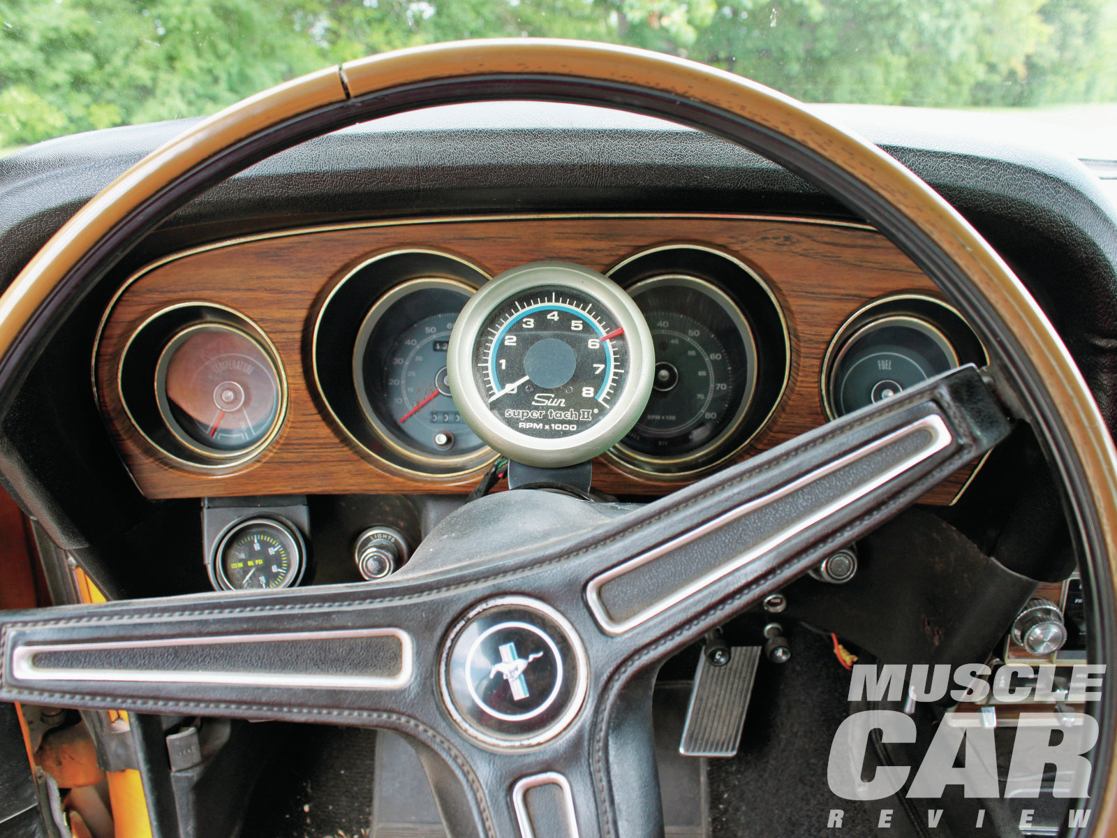 """The Mustang's interior is mostly factory stock, with a few stickers and other additions Keith has done over the 30-some-odd years he has owned the car. """"Yes, I know it needs work, but it's original."""" Keith added the Sunpro tach to the column and also put in a mechanical SW oil-pressure gauge. The speedo hasn't worked since 1977."""