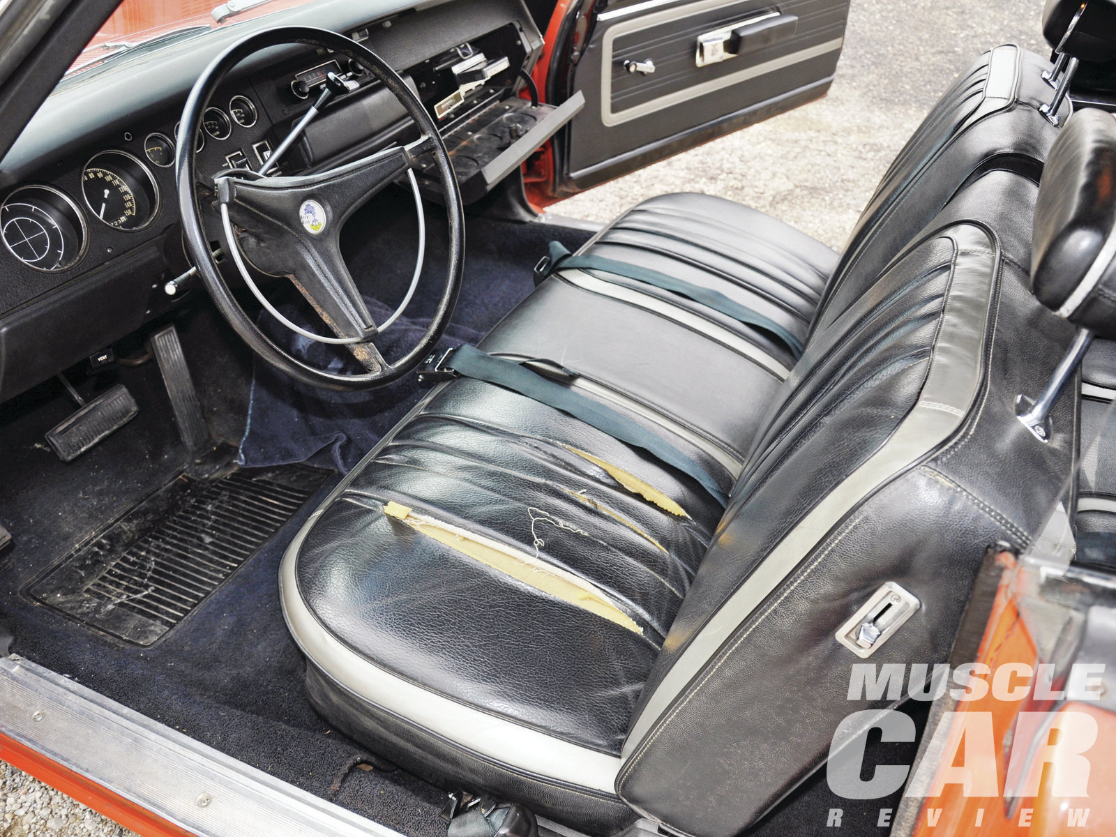 Bucket seats were optional on the Superbird, and Kent's car doesn't have them. Some people see the column shifter and quickly dismiss the car as a fake. The seats show some wear, which, for the owner, only enhances the car's authenticity.