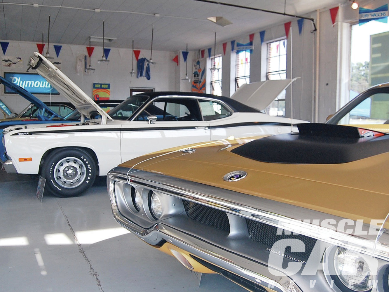 Carlisle's Beeney Motors was dressed out like a Chrysler dealership, circa 1972. Among the cars in the showroom were this '72 Duster and Road Runner, both powered by 340s.