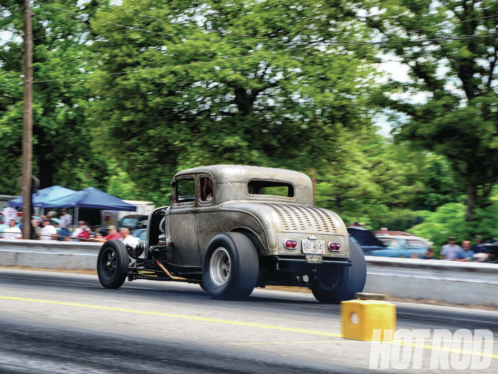 Here's Josh Flammer's Deuce five-window coupe in its natural environment, punishing rubber 10 seconds at a time. It's downright nasty, but in the best way.
