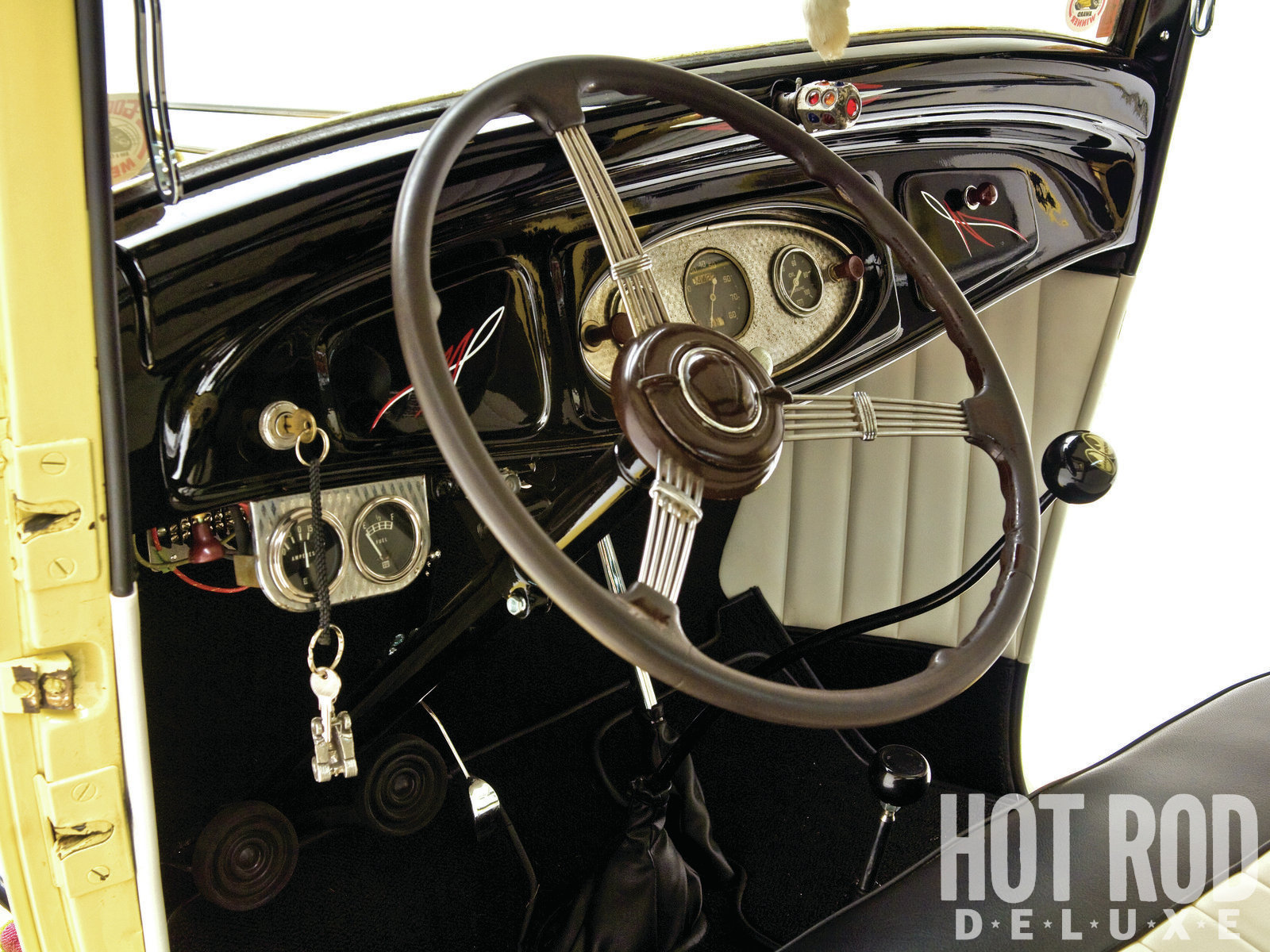 Original Stewart-Warner gauges, subtle 'striping, and a unique, jeweled light came together in a sexy dashboard.