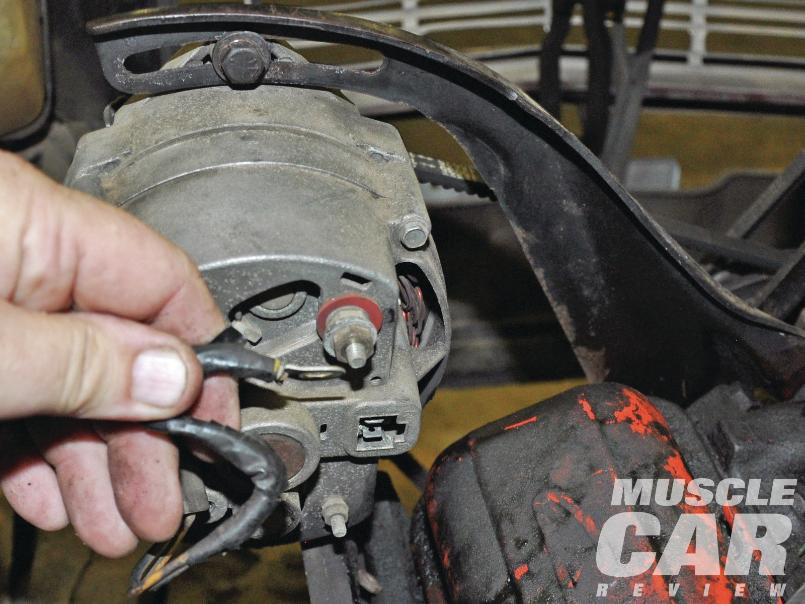 All wires and linkage have to come off the engine. Even if you intend to replace your wiring harness, it still pays to take time to remove all clips and brackets. Bag and label all items, and keep them in one place.