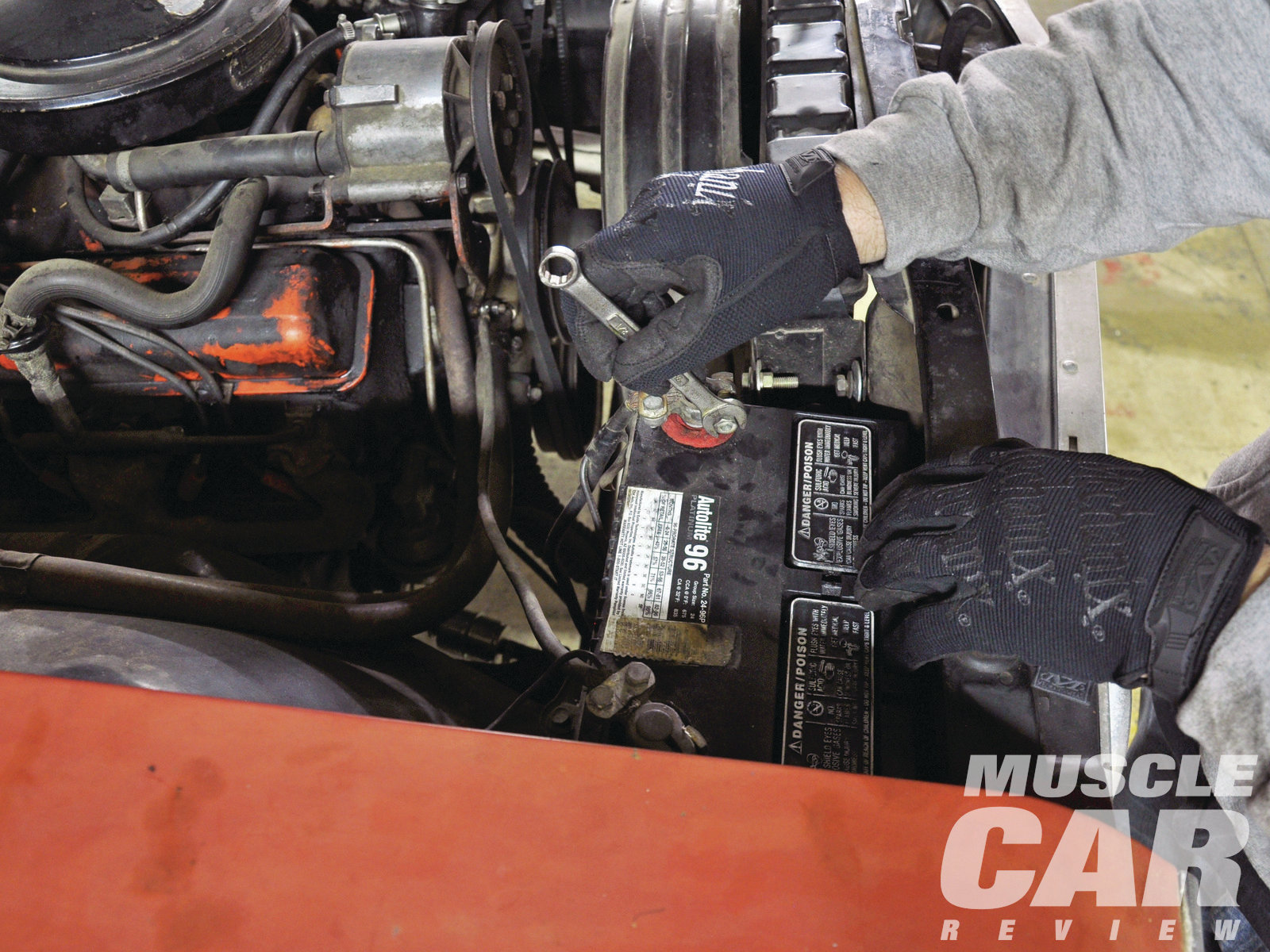 The very first thing to do when swapping engines is to disconnect the battery. Wearing some sort of mechanic's gloves, like these from Mechanix Wear, is recommended to avoid injury caused by contact with the battery's corrosive materials.