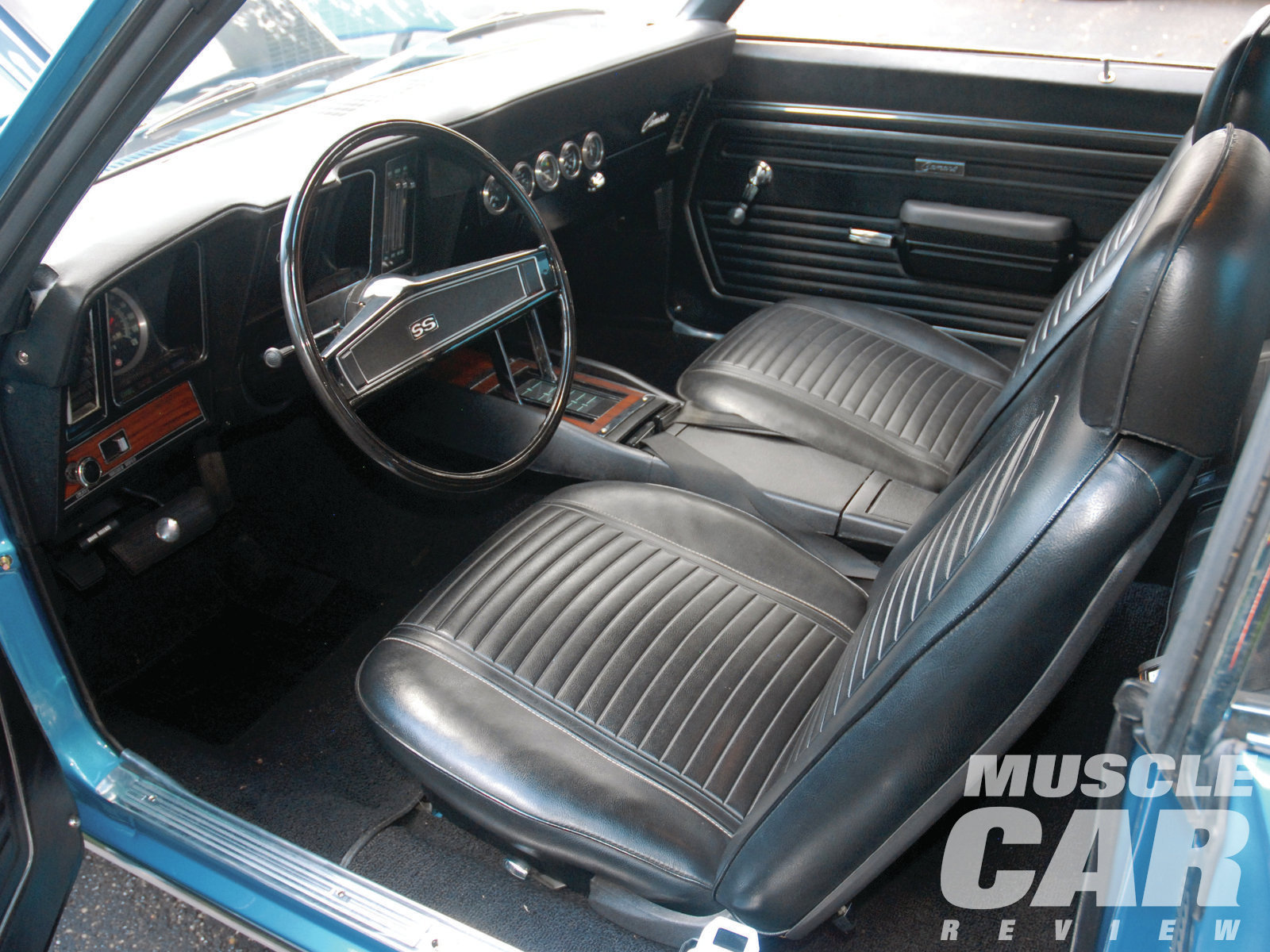 The original black vinyl, high-back bucket seat interior is still with the car. The only thing that needed to be replaced was the carpeting.