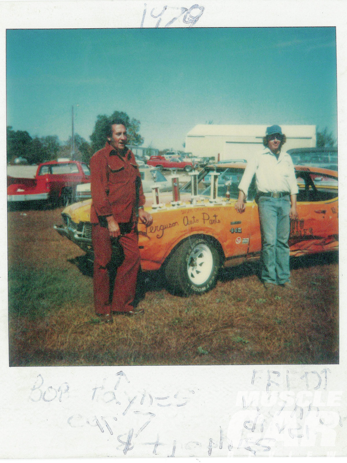 Adam found this old photo of his father, Fred Withrow (right), and his grandfather, Bob Haynes (left), standing in front of the '69 4-4-2 that Fred raced. Adam plans to build his '69 4-4-2 rare find into a tribute to his father's old circle-track race car, right down to the color and decals.
