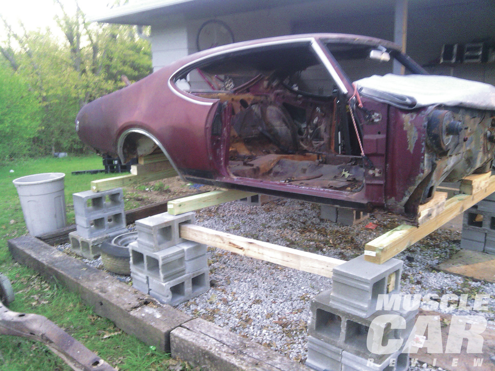 """Adam wasted no time getting started on the Olds. He stripped the car and set it on 4x4 posts and cement blocks. """"All the body panels will be covered for winter, and hopefully next spring I can get started on it again."""""""
