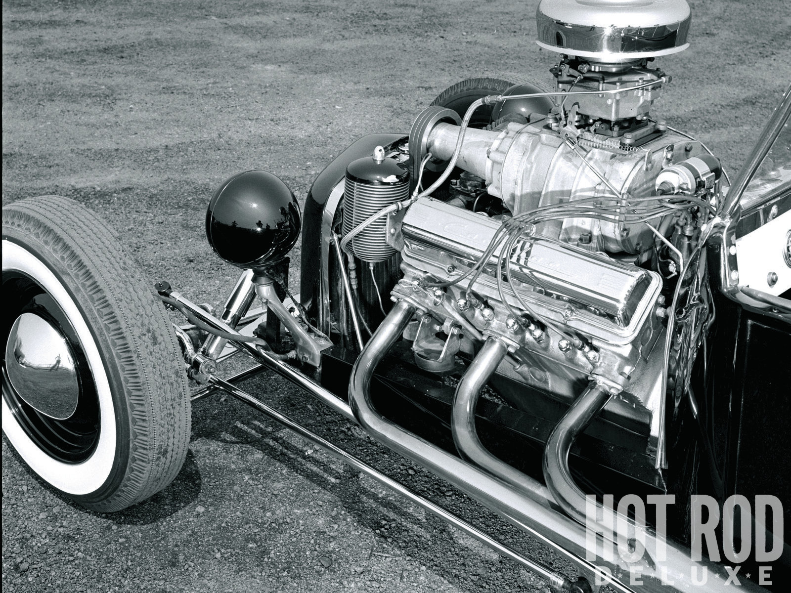 """Internally, the Caddy was left as GM intended, except for aftermarket solid lifters. Studebaker rocker arms were mounted on shortened Cad pushrods to increase valve lift. That's the stock Rochester four-barrel atop the blower and what HRM described as """"a Bandimere special manifold."""""""