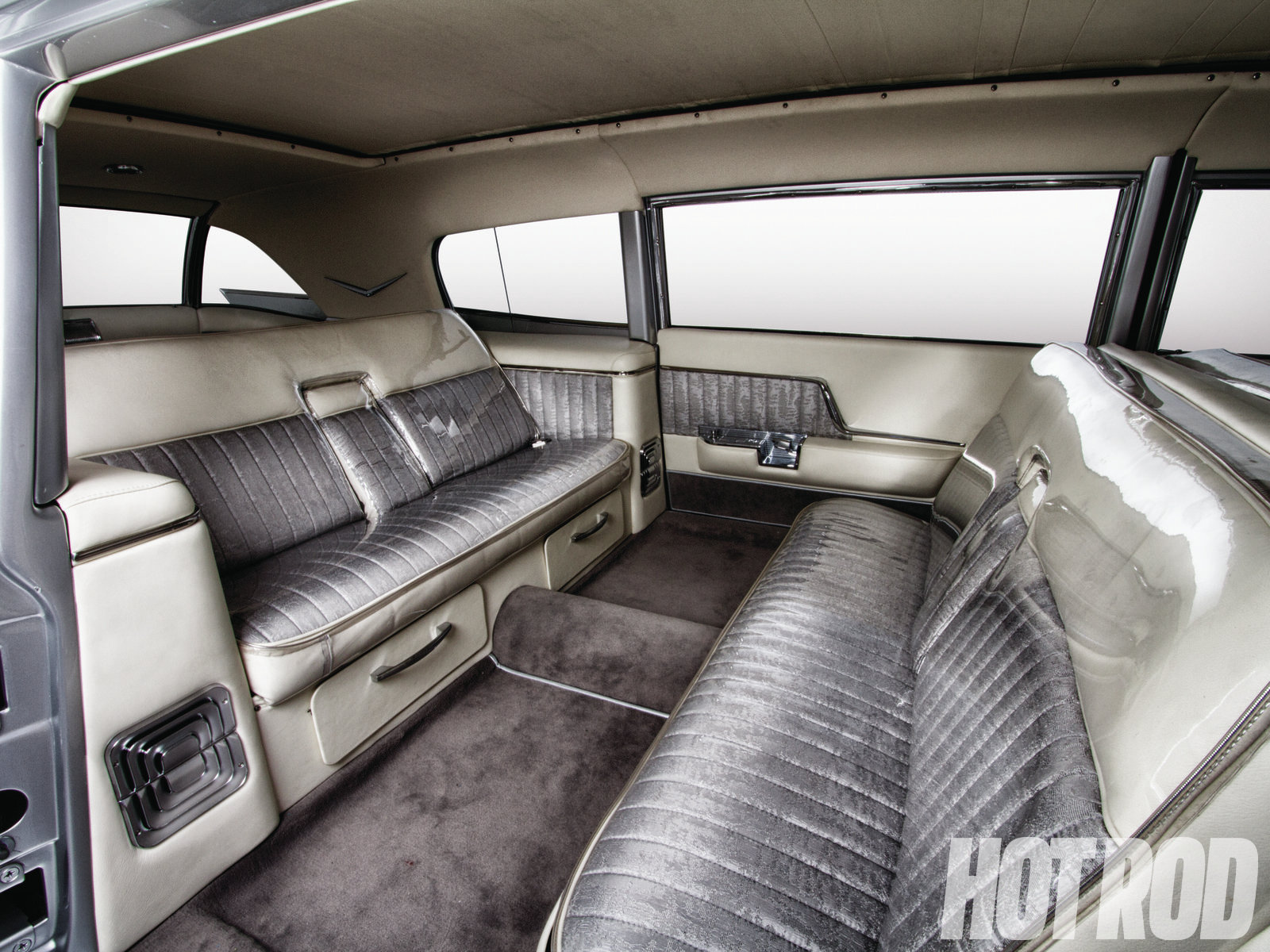The interior might look all original, but it's far from it. The door panels have '57 fresh air vents that cover the speakers and interior lights, the door handles are '62 Cadillac, and the rear seat is all custom.