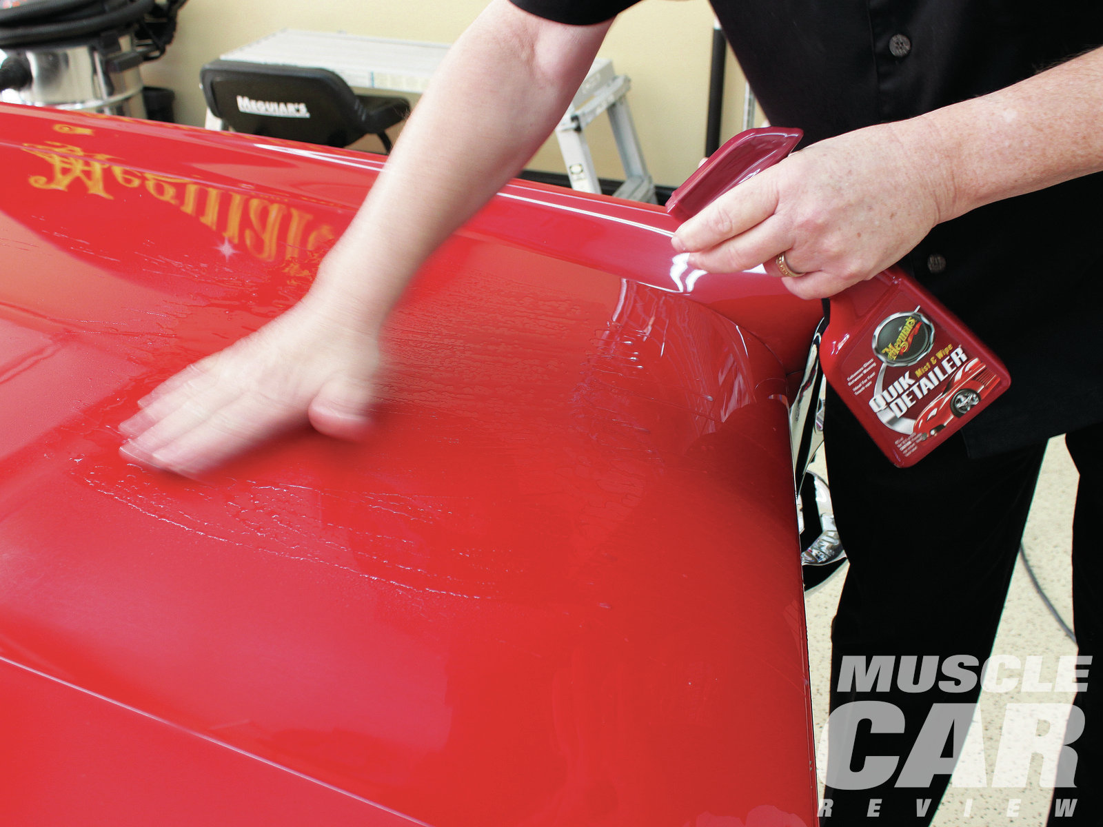 "The two-stage (basecoat/clearcoat) paint on Mick Batson's '67 GTO presented a different scenario. Though it was applied way back in 1986, the Regimental Red finish had great eye appeal, but close inspection revealed some issues in the clearcoat. The panels had a rough feel to them, indicating contaminants were bonded to the paint's surface. These have to come off first so you don't grind them into the paint during subsequent steps. A clay bar skims off those imperfections easily. Use plenty of Quik Detailer to lubricate the clay, and don't rub any harder ""than you would pet your dog,"" said Mike."