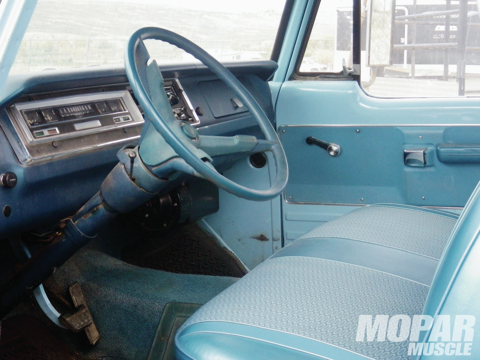Interior: The odometer on this Dodge shows only 97,000 actual miles, and the interior is in great shape. It's unusual for a truck of this era to have carpeting, and the seat, dash, headliner, and door panels are in amazing shape for their age.