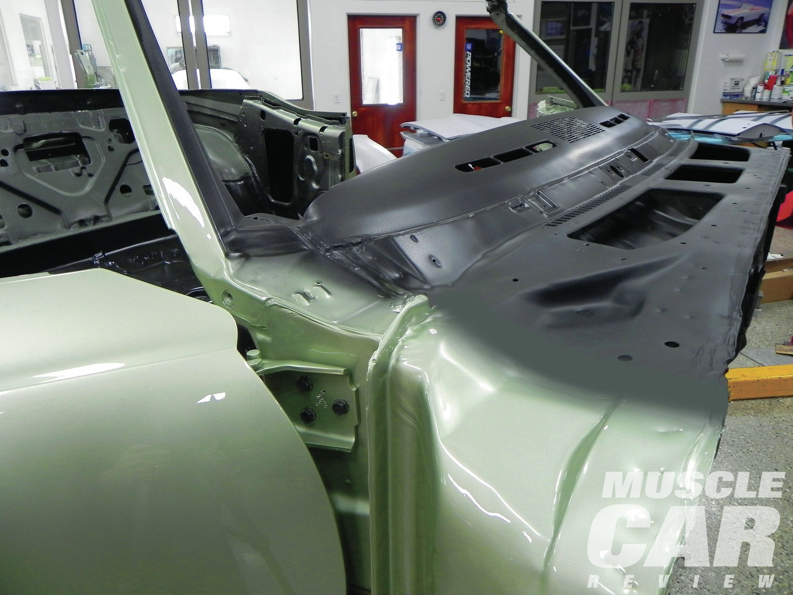 The cowl is painted flat black, and the body color comes right up to it. The final layer, the dash color, is applied over the top of both of them. Be sure to black out the windshield pillar on the edge and inside since you don't want to see body color on this area when the car is finished.