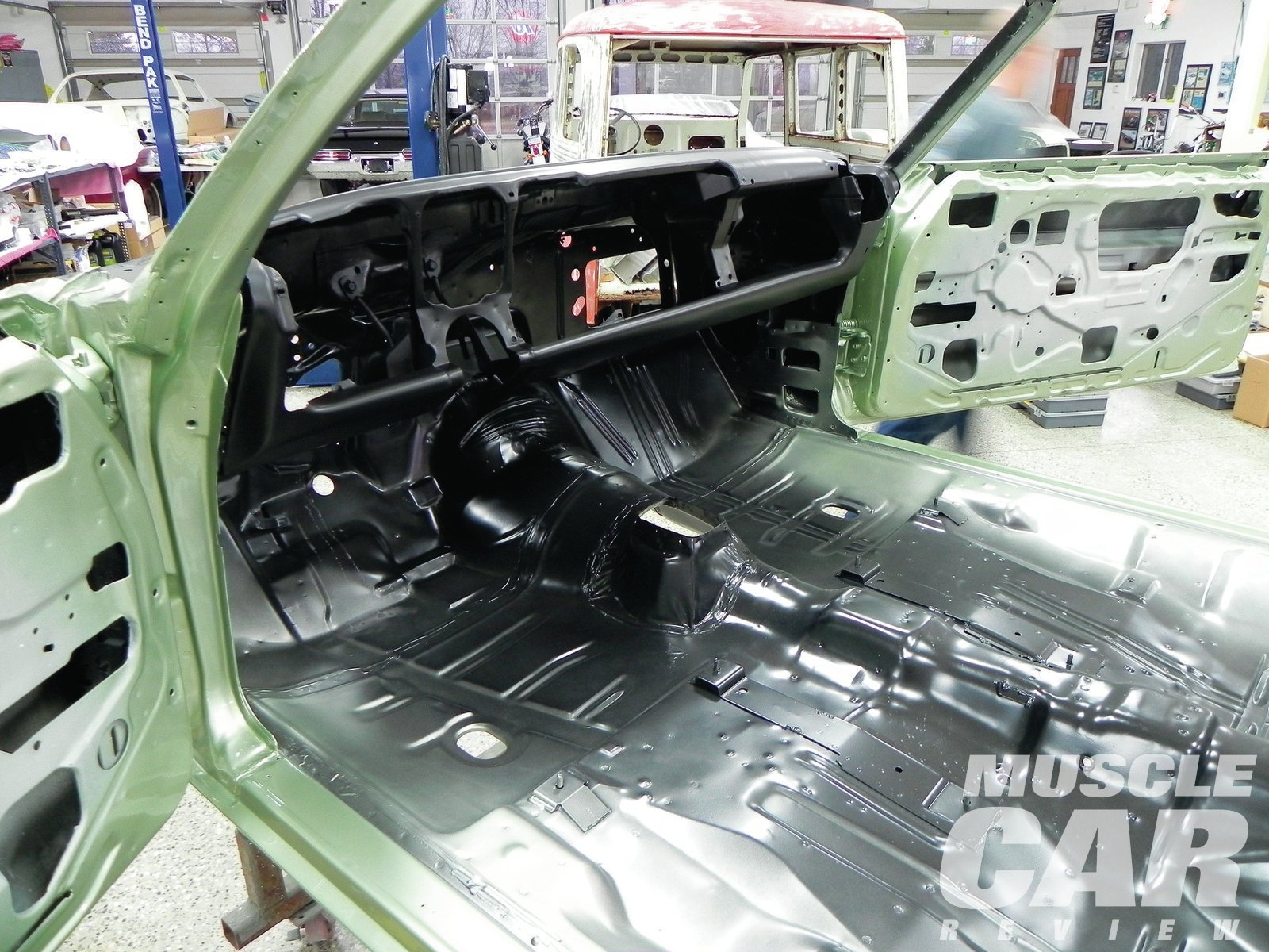 The body's interior is painted black, and the overspray is  applied over the black. The dash is painted a flatter black, which is applied after the body paint and overspray. It is the last color applied.