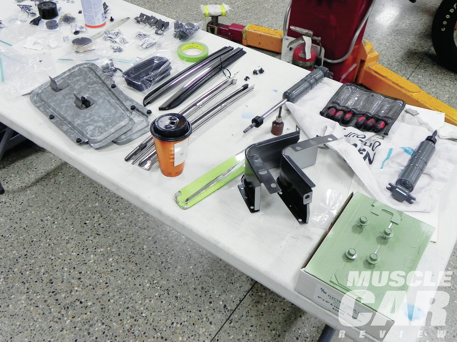 Small pieces, like trunk shims and bolts, can be painted and put in later, although the parts would have been together when the car was painted at the factory.