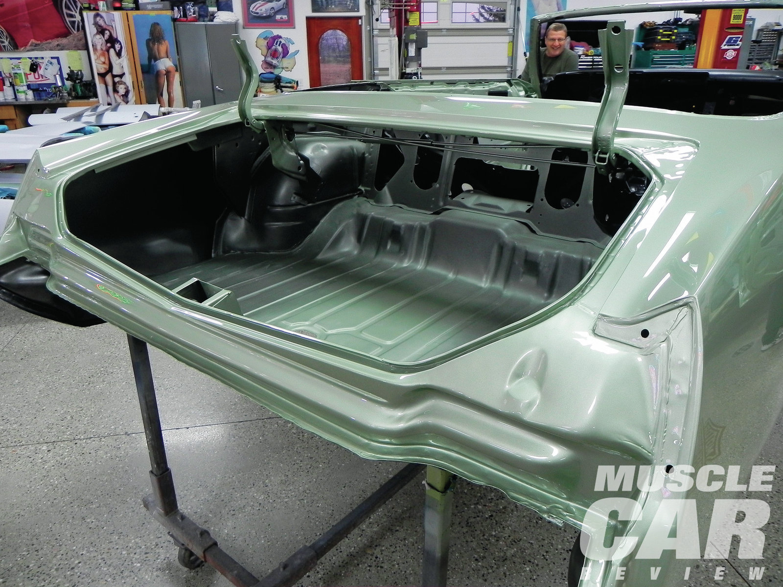 The trunk area is masked off and painted black first, then the body is masked and the overspray is lightly applied. The drain plugs do not get painted and are installed after all painting is complete but before adding the trunk splatter paint.