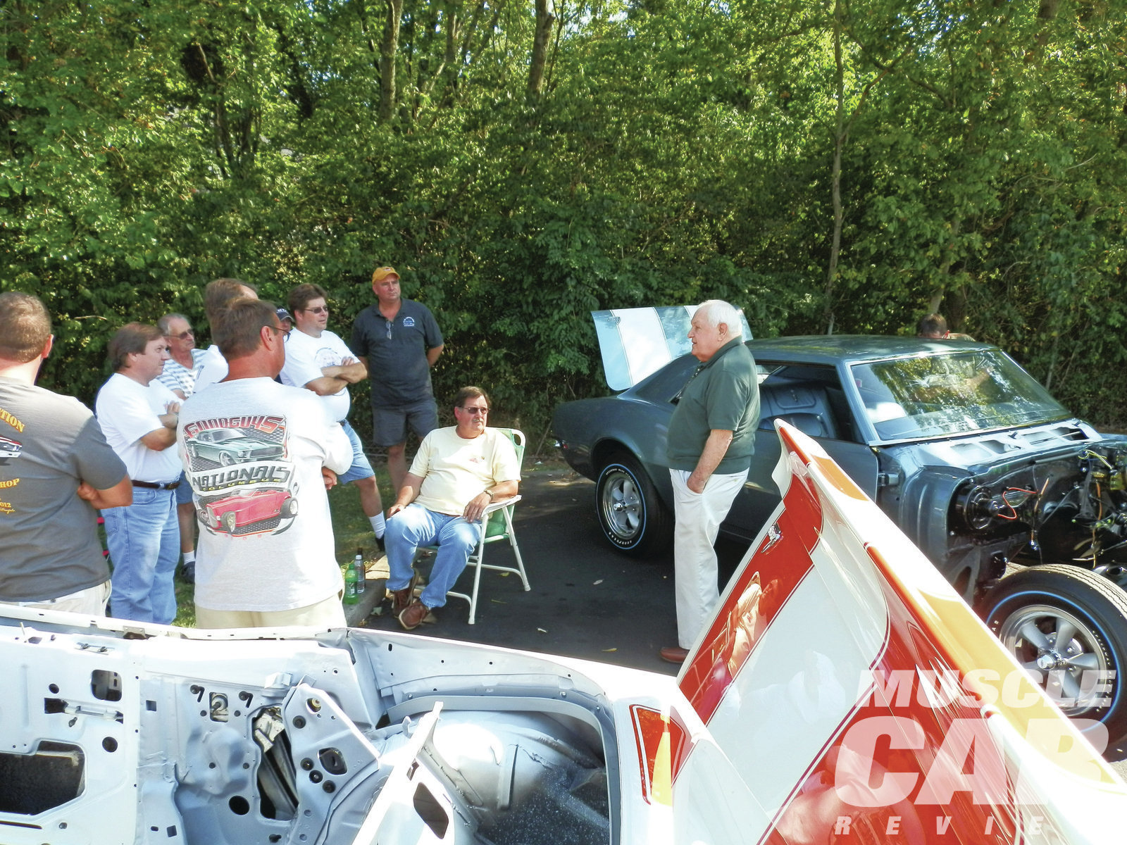 Norwood retiree Jim Seim (below) talks about assembling Camaros at the plant's reunion. The Super Car Workshop had a couple of in-process restoration projects at the Norwood reunion, including this '68 Z/28 (behind Jim) originally sold through Yenko Chevrolet.