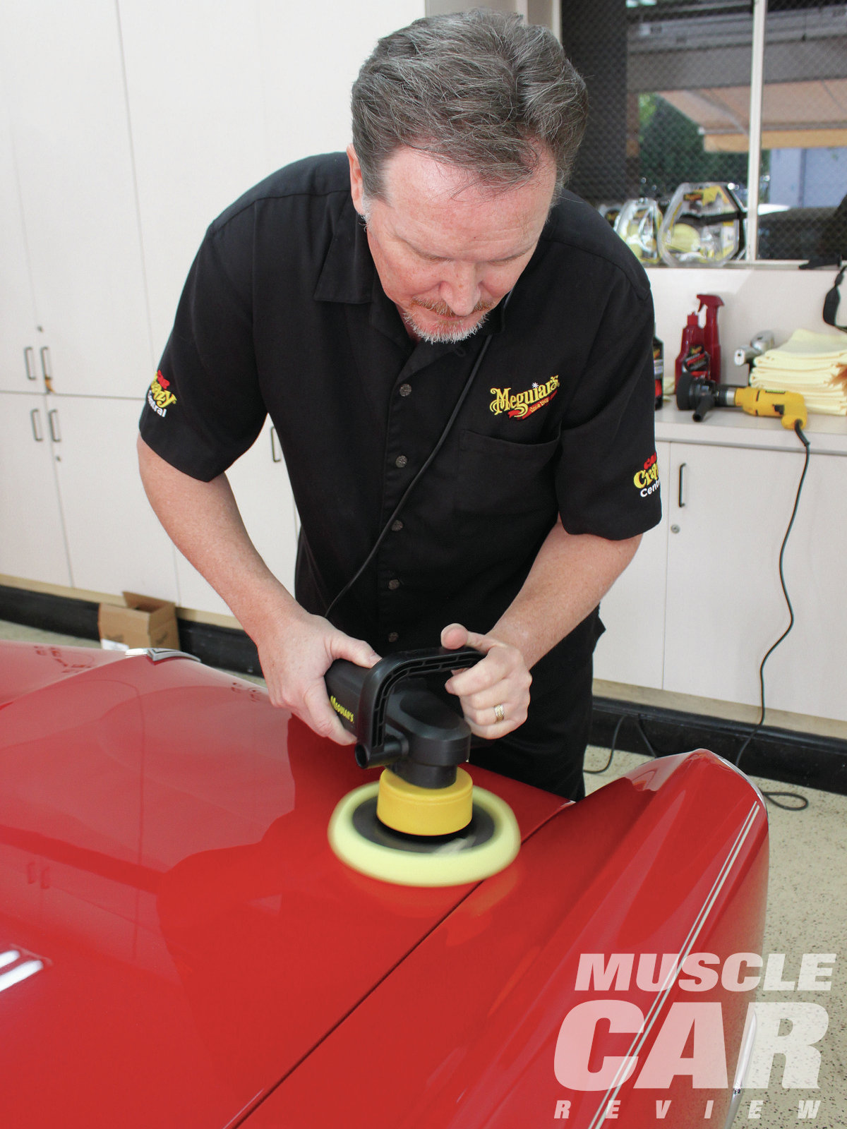 "As on Eric's Judge, Mike applied the compound to a fairly small area, working the DA back and forth and up and down to spread the compound evenly. ""It would be hard to burn the compound into the paint using the machine,"" he says. ""You run a bigger risk of damaging the car with the DA by dropping it on the car."""