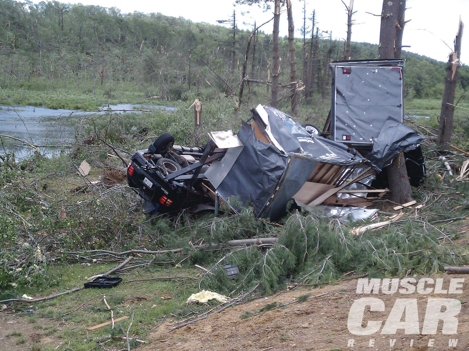 "The tornado wasn't picky. Francisco ""Cisco"" Gonzalez's new Toyota Sequoia tow vehicle (still connected to the trailer) and a mint, low-mile '86 Buick GN were also destroyed. The black form to the right of the trailer behind the tree trunk is the front end of the formerly mighty turbo Buick, now reduced to junk."