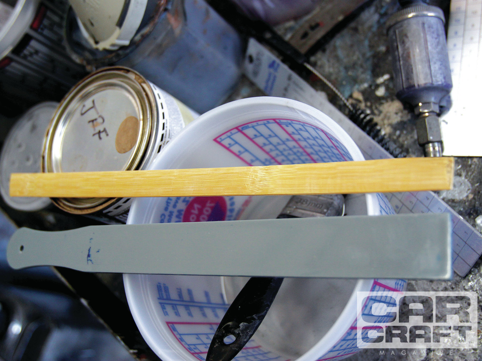 One interesting tip Praveen shared with us was his recommendation to use plastic, rather than wood, stir sticks with waterborne paint. He described a few instances where the tints had separated out of the waterborne base and wicked up into the wooden stir stick. It wasn't much but apparently enough to affect the final color of the car. He says he now only uses plastic stir sticks to mix waterborne paint.