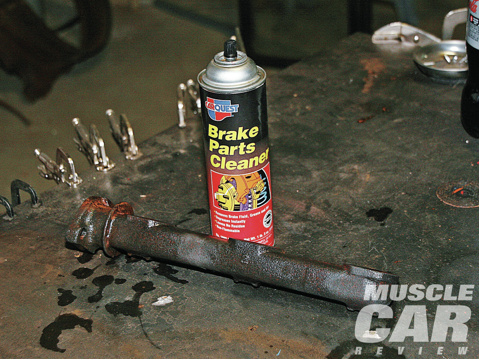 Any time you derust cast steel or bare metal and then rinse it, it flash-rusts, even if you get the water off quickly with an air gun. We figured that if we could displace the water and separate it from the steel's surface we would eliminate that chemical reaction. While the part is still wet with water, we spray it with brake cleaner. The brake cleaner displaces the water, getting between it and the surface of the metal. Once the part is saturated with brake cleaner, we let the brake cleaner evaporate, leaving rust-free, bare steel.