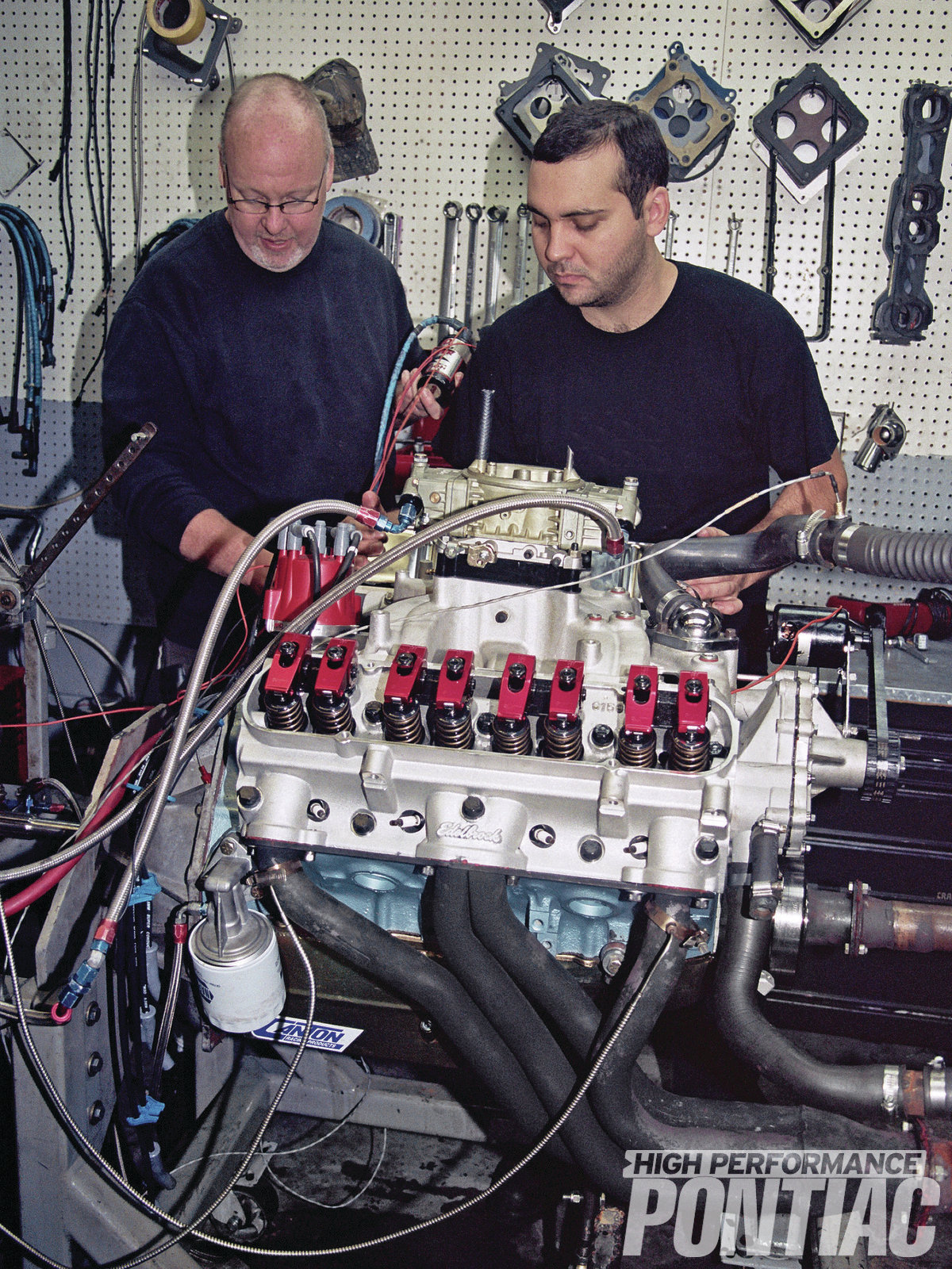 Craig Wise and Corey Porter prepare The Mule for dyno testing with the Edelbrock Performer D-Port heads and 92-octane pump gas.