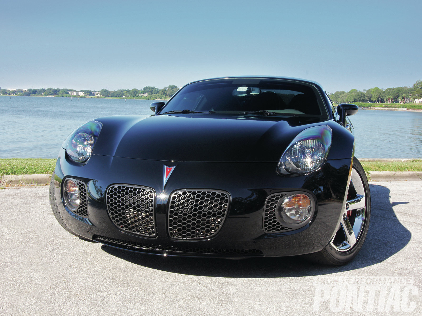 """The clean lines of the Solstice are thoroughly modern, yet harken back to the great sports cars from the past and even to Pontiac's attempts to bring a two-seater to market in the '50s and '60s. You have to look, but there is a little XP-833 """"Banshee"""" in these vehicles, the coupe in particular."""