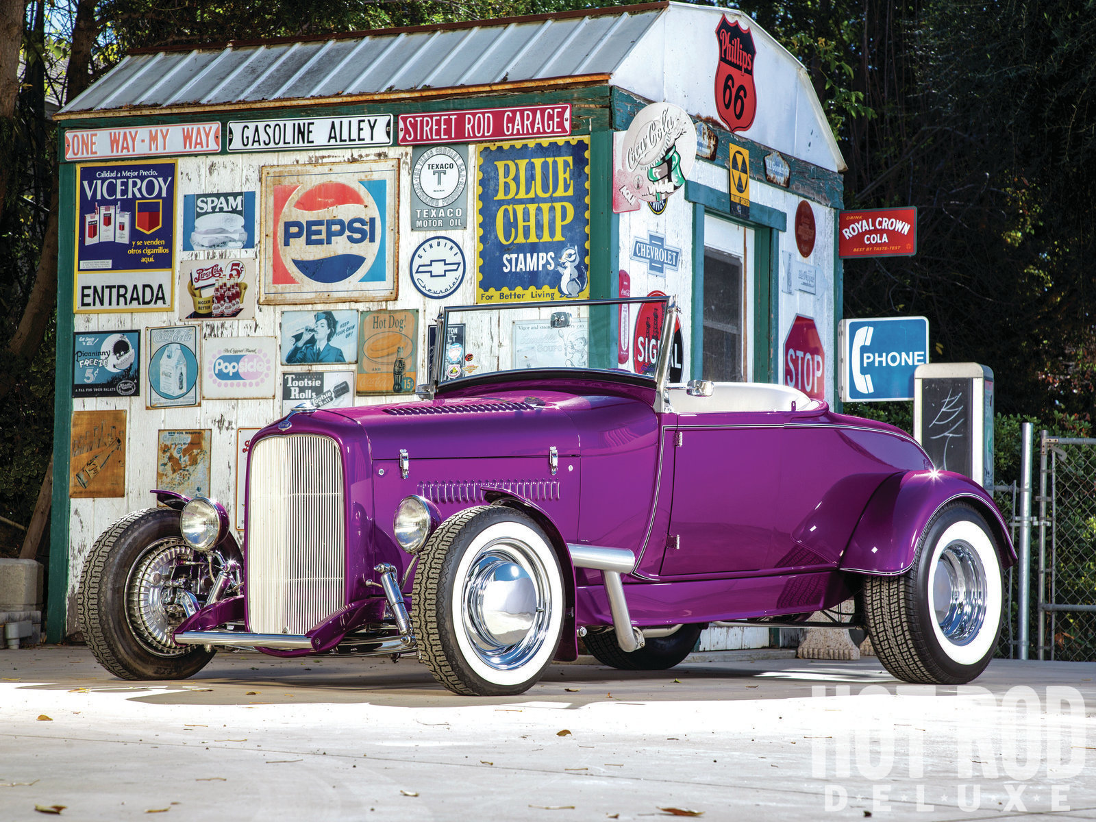"""If this angle of Rich Guasco's '29 highboy doesn't turn you on, you're reading the wrong magazine. The character lines on both the '29 roadster body and the '32 frame, as well as the frame's easy adaptability to the V8, make it easy to understand why rodders went for this combination decades ago. The rubber rake, outside headers, cycle fenders, and louvers all scream """"traditional hot rod!"""" The grille shell has been chopped 3 inches but retains the stock cap and trim."""
