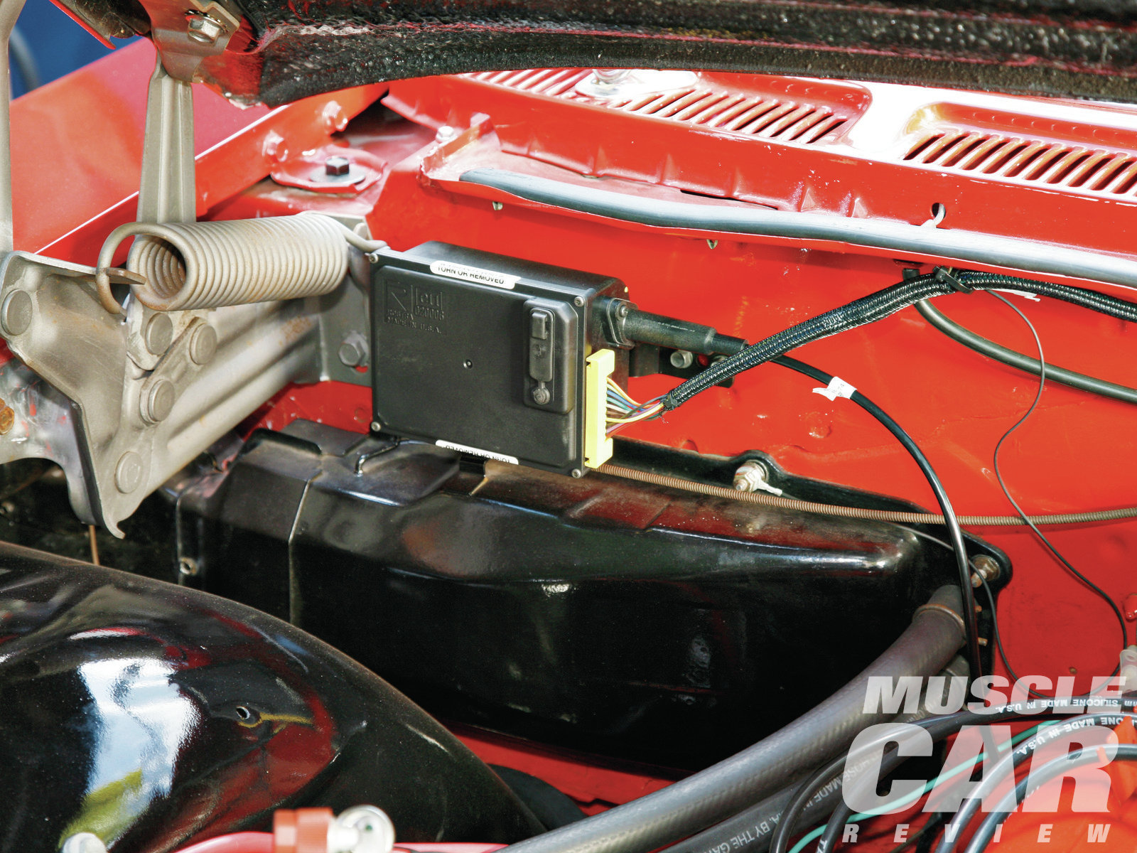 Dakota Digital's compact cruise-control module can be mounted almost anywhere in the engine compartment. We chose the area above the heater box on the firewall. It allowed for easy routing of the throttle cable and wiring.