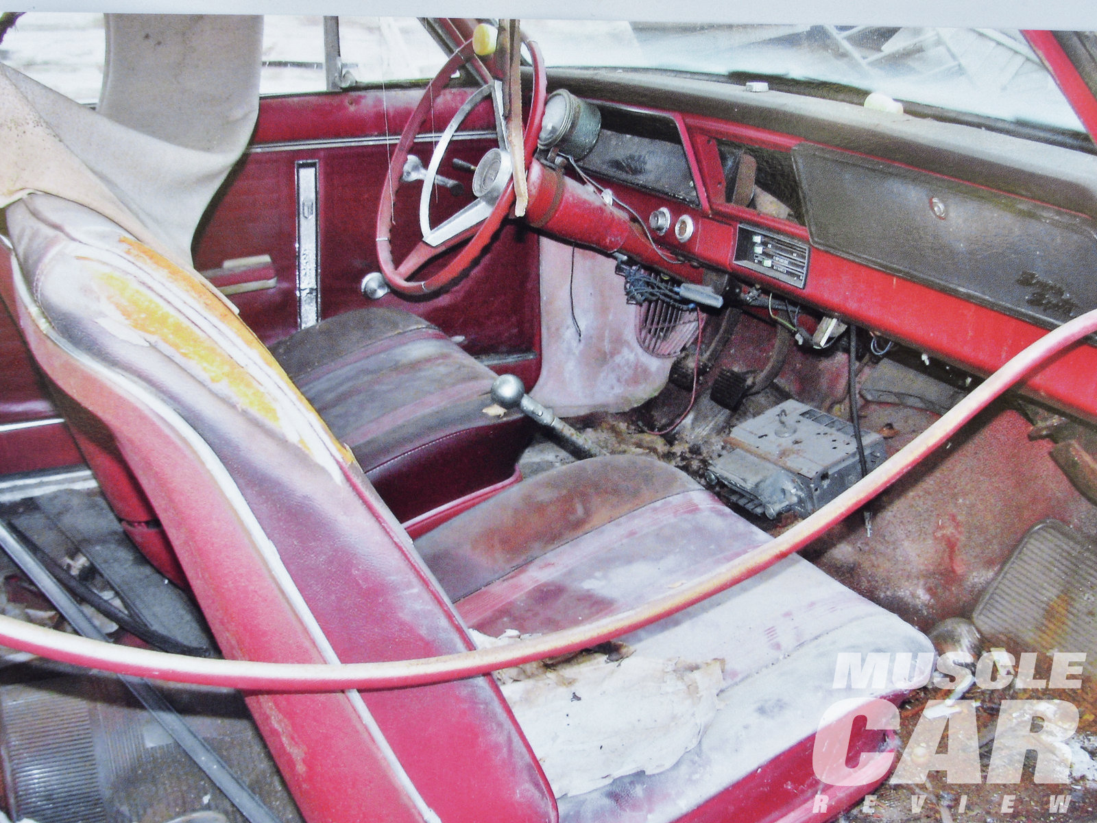 The interior is complete with bucket seats and the four-speed shifter. What are the odds a '66 Nova on a farm would be a rare L79?