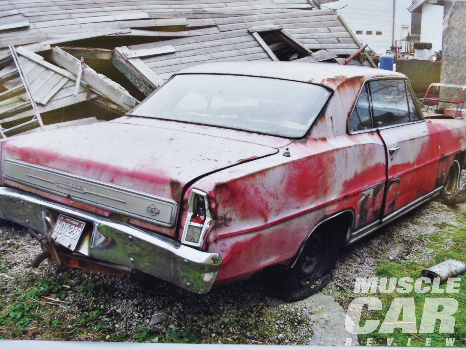 "Sitting outside since 1971, the '66 Nova SS was rusty but in remarkably good condition considering Michigan winters. The rear license plates read ""1971,"" the year the farmer parked his L79. Tim Lay says, ""The story is he raced it, and he lost, and he was ticked off about it."""