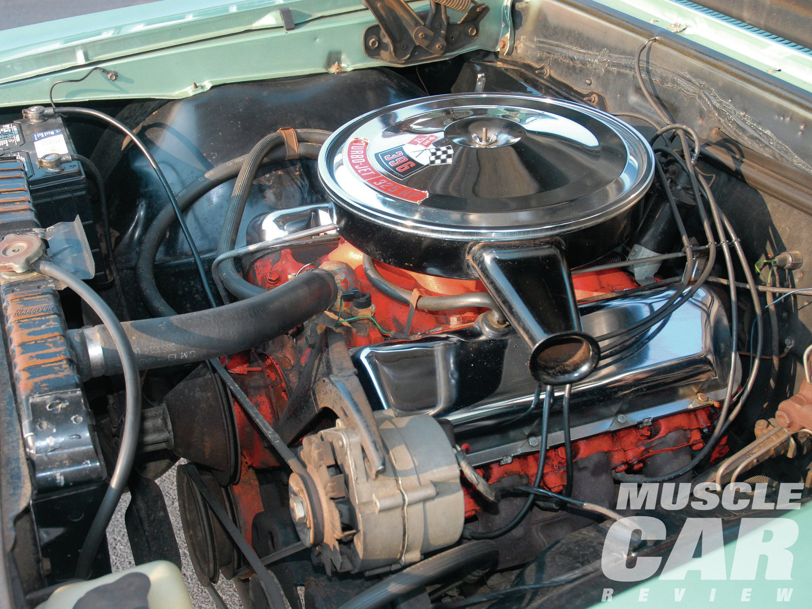 This particular Chevelle SS came equipped with the lower-compression (10.25:1), Rochester-carbureted 396ci big-block. Though the car is low-mileage, the engine bay wears the patina that comes after nearly a half-century.