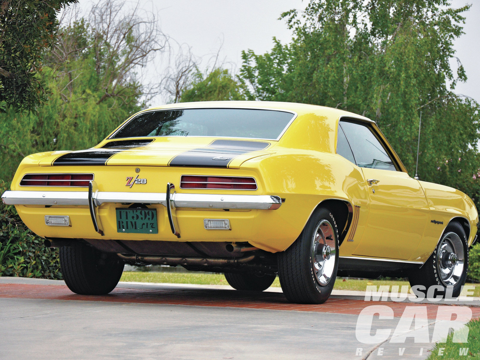 The 12-bolt Positraction rear spins 3.73 gears. All '69 Z/28s had rear bumper guards. Most Z/28s had the G31 four-leaf spring packs, which some believe altered the ride height enough to require the use of the rear bumper guards. A few documented Z/28s have been discovered to have been built with the five-leaf rear springs. Correct Goodyear Polyglas E70-15 tires and Rally wheels serve as the perfect complement to the rocker and wheelwell trim.