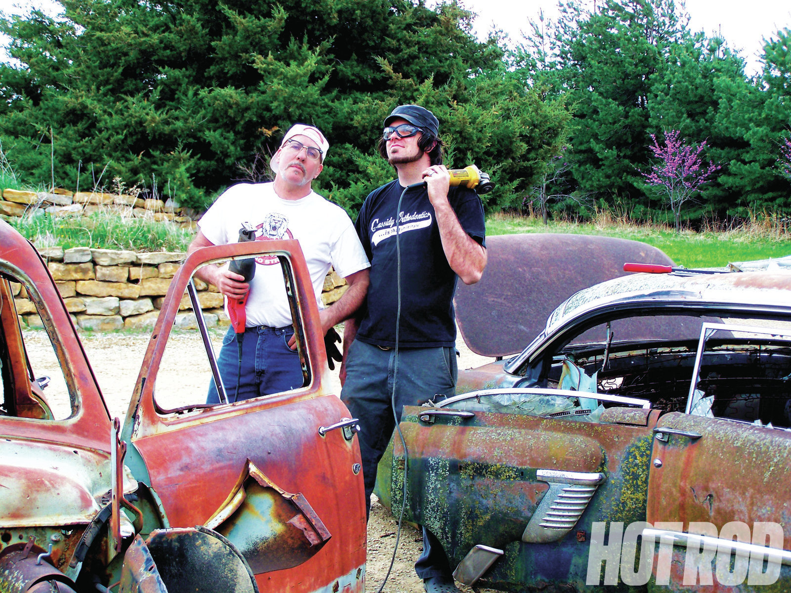 Last year, Bob and Garrett Larson never made a full pass at Drag Week™. Bob blew the rearend in his 38 Special coupe, a mix of body parts from 30 different cars, right on the starting line. Over the winter, the father-and-son team repaired the 38 and built a roadster for a buddy using parts from a '41 Plymouth four-door, a '58 Chevy straight-axle, an '88 Chevy rearend, a '56 Ford trunk lid, '37 Chevy wheelwells, a 500-cube Caddy motor, a '38 Dodge grille, a '50 Ford roof (for a rear pan), and '37 Chevy taillights. The Plymouth, uh, Ford, er, Dodge has a 130-inch wheelbase and sits 3 inches off the pavement!