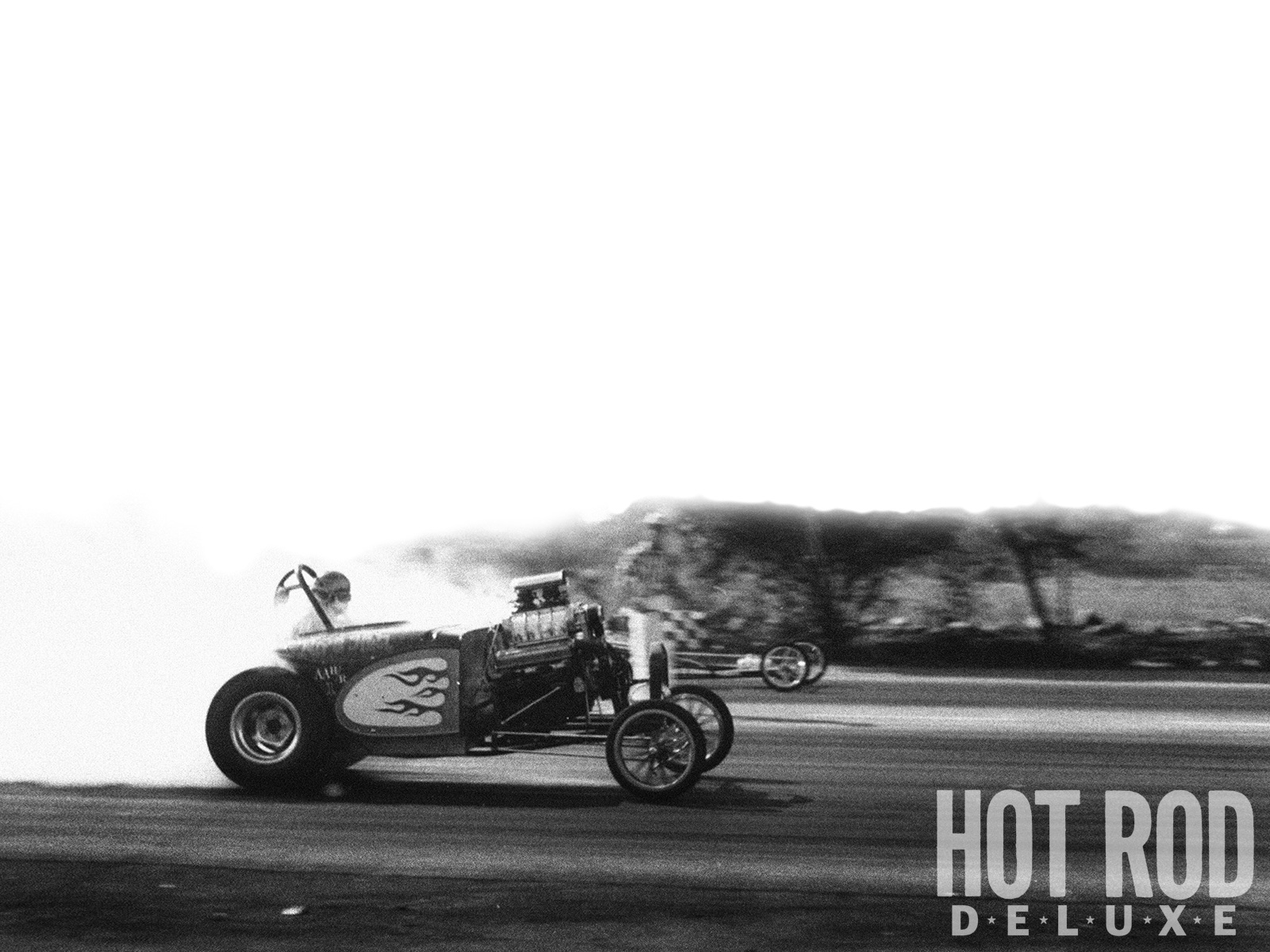 Pure Hell occasionally stopped at San Fernando Raceway en route home from a Saturday-night meet somewhere in Southern California. Rather than collect an easy AA/FA class trophy, Rich Guasco and Dale Emery would qualify and race against Top Gas Dragsters such as George Bolthoff's (which won this round with an 8.31 at 189.86, says the back of the print). The starter seems to be wondering what little Sky Wallace, age 11 or 12, is doing out there with our dad's fixed-lens 35mm camera. The kid's photo was never published, until now.