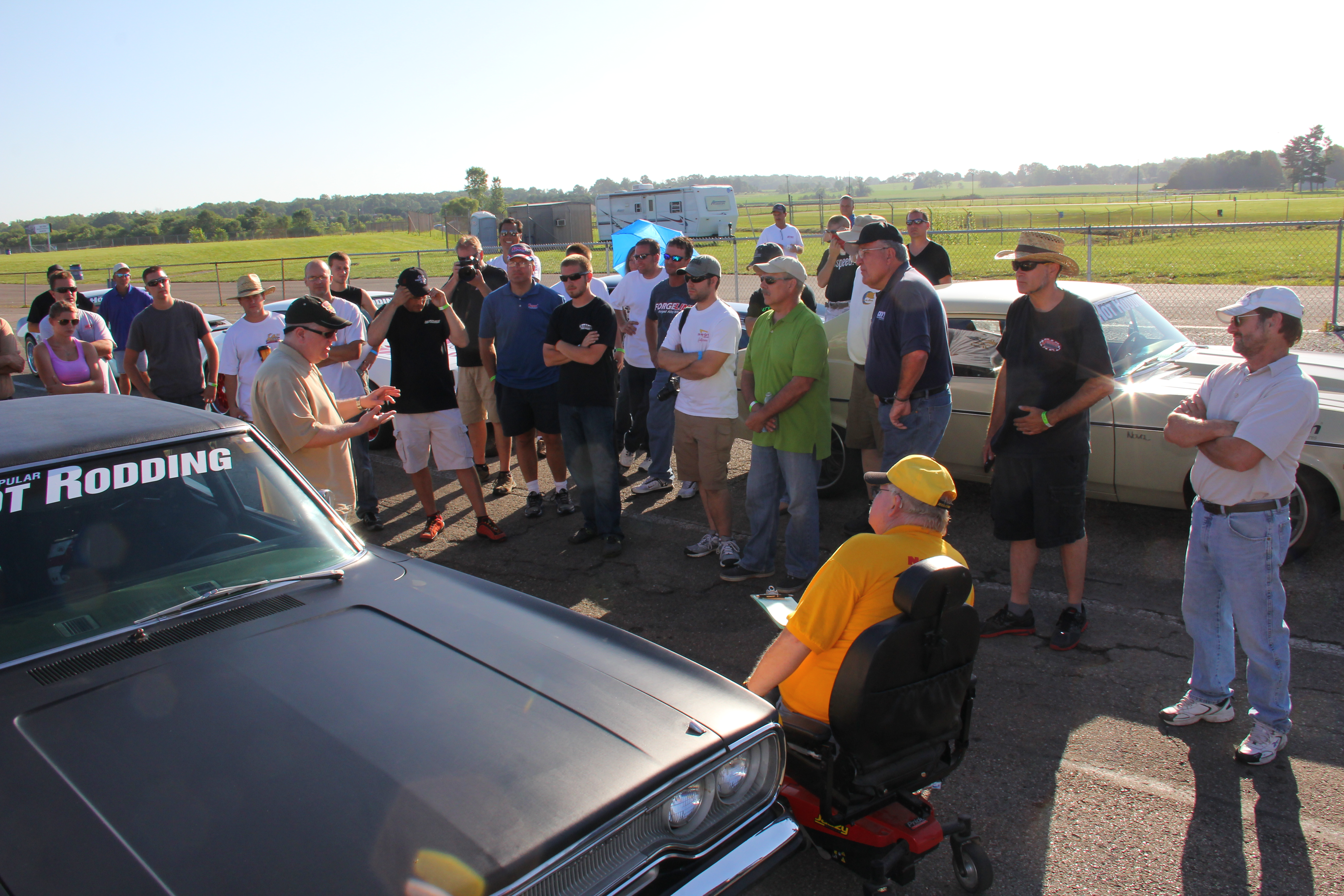 Here, Editor of Popular Hot Rodding Magainze, John Hunkins, heads up the driver's meeting, which went over the amount of runs each driver gets as well as safety. From here, we're all set to have some fun!