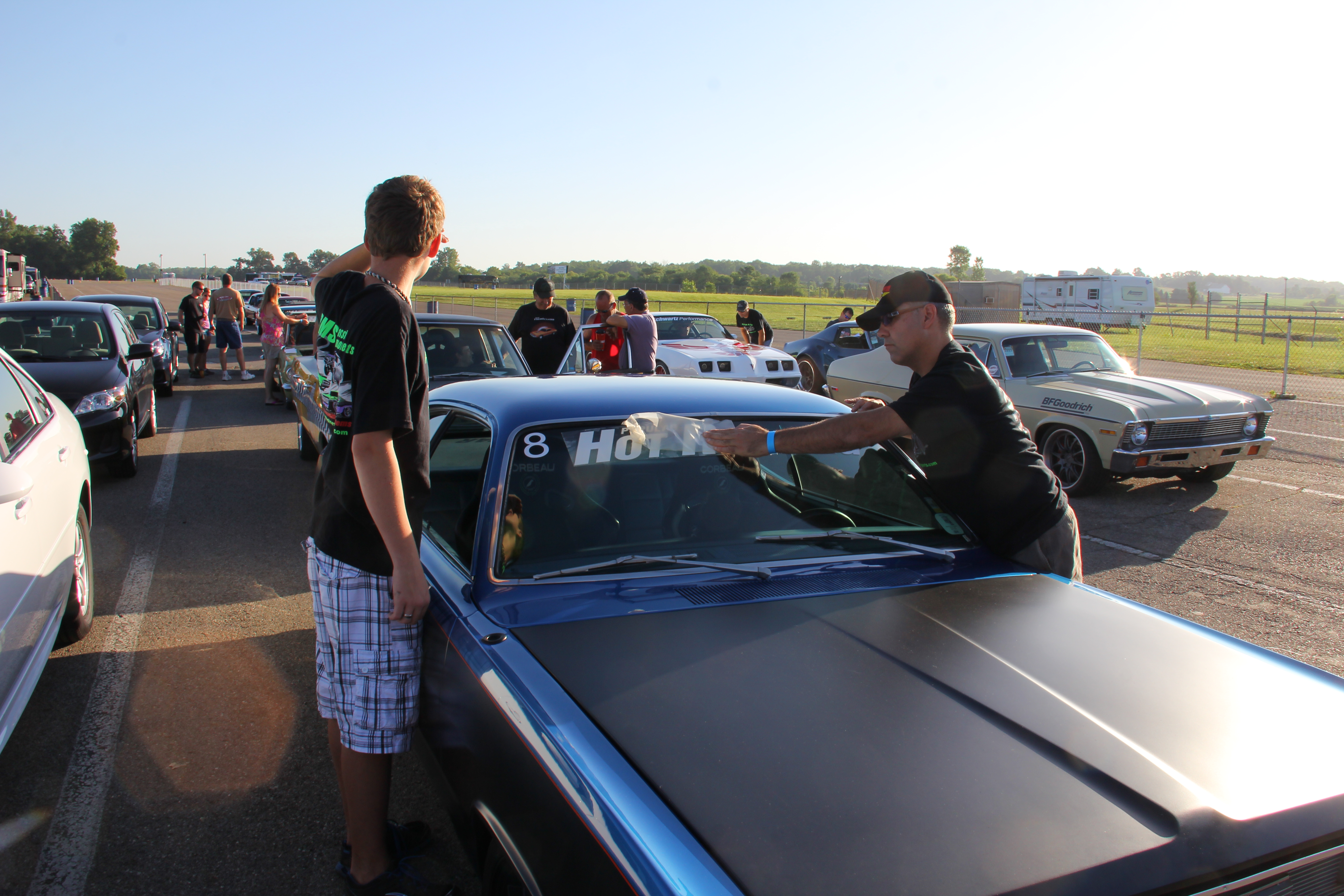 Participants add the required windshiled banner to vehicles in order race and compete.