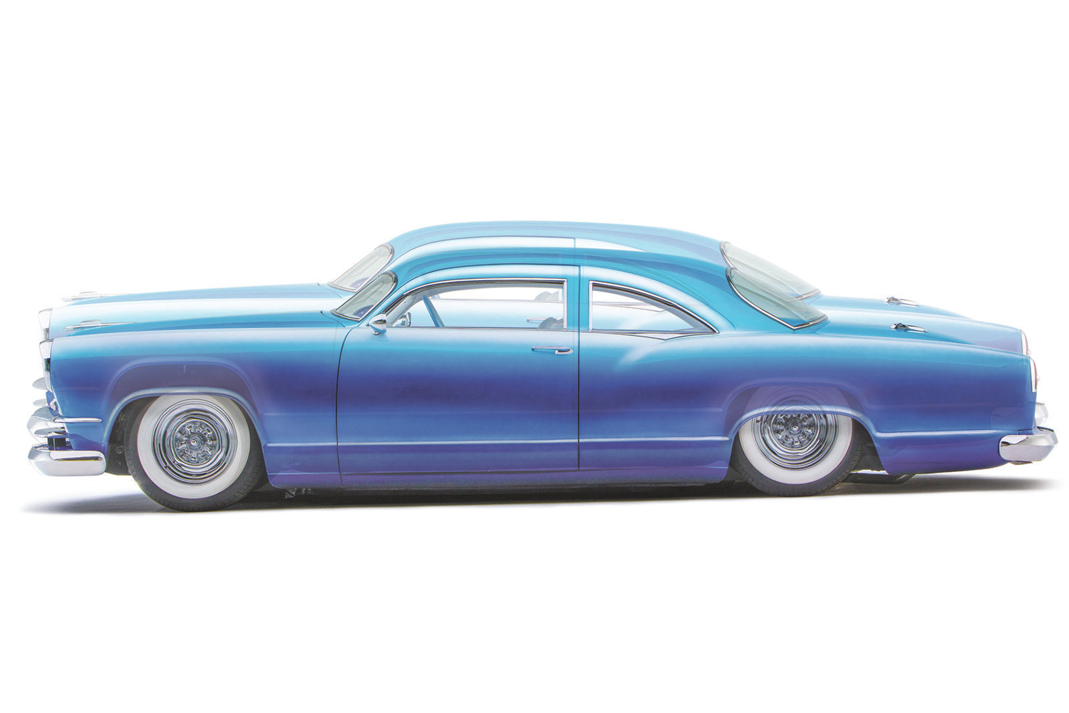 The Kaiser drops it low, thanks to a 1995 Chevy Caprice frame with notched rear and trimmed front sitting on Slam Specialties RE-7 airbags in the front and RE-8 bags in the rear. This photo demonstrates the highest and lowest airbag settings.